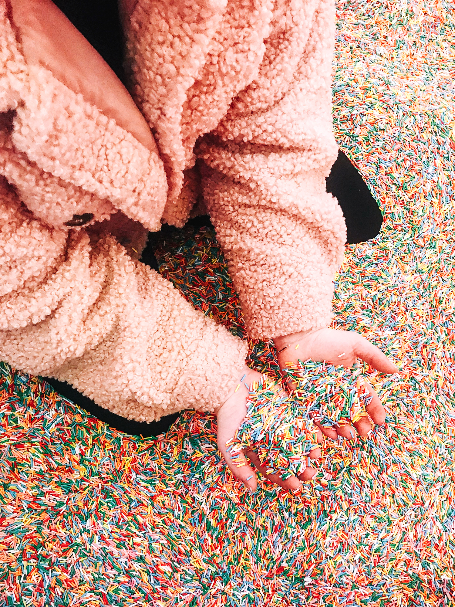 san francisco museum of ice cream girl in pool of sprinkles