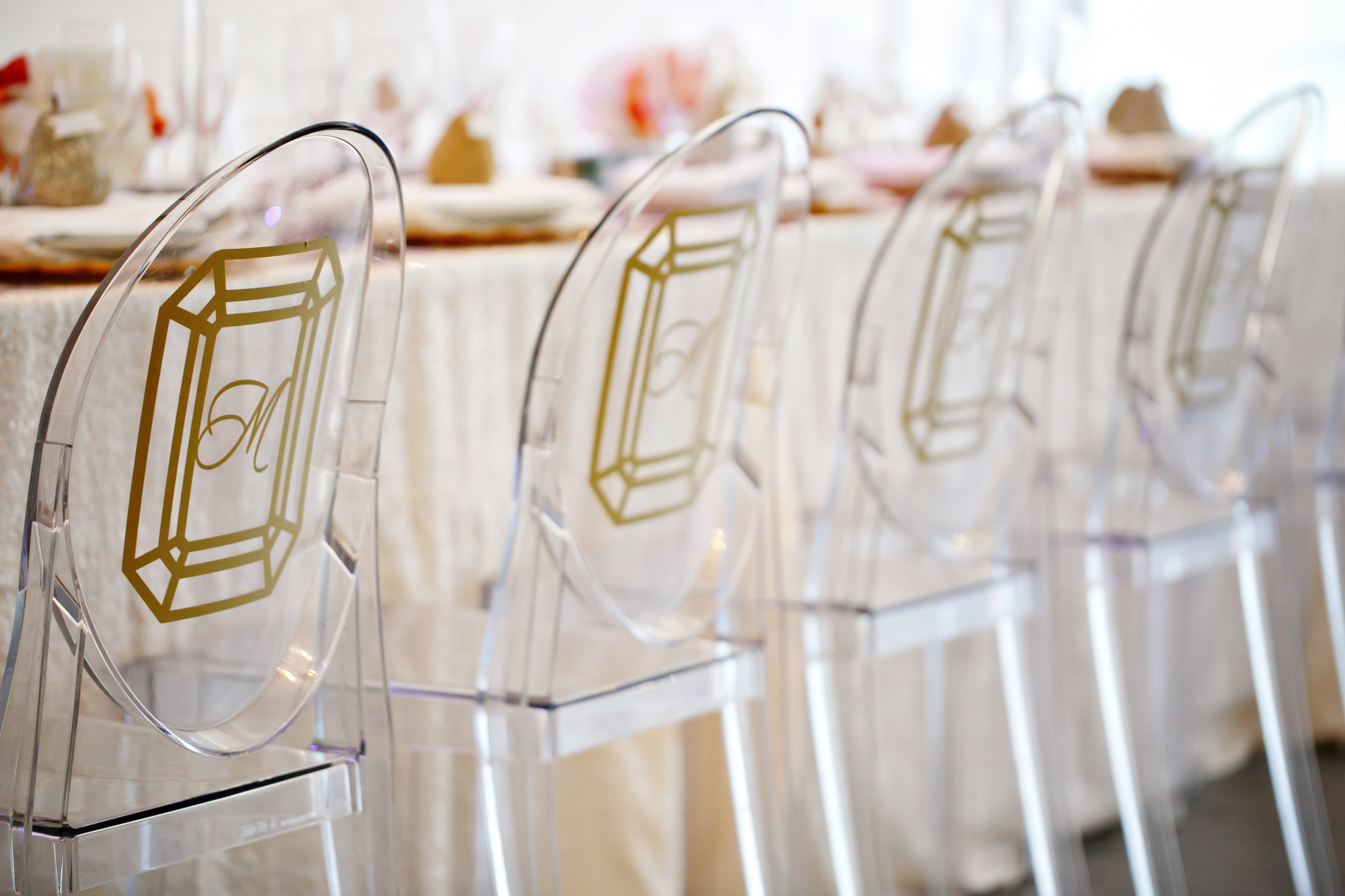 ghost chairs with diamond vinyl monogram stickers