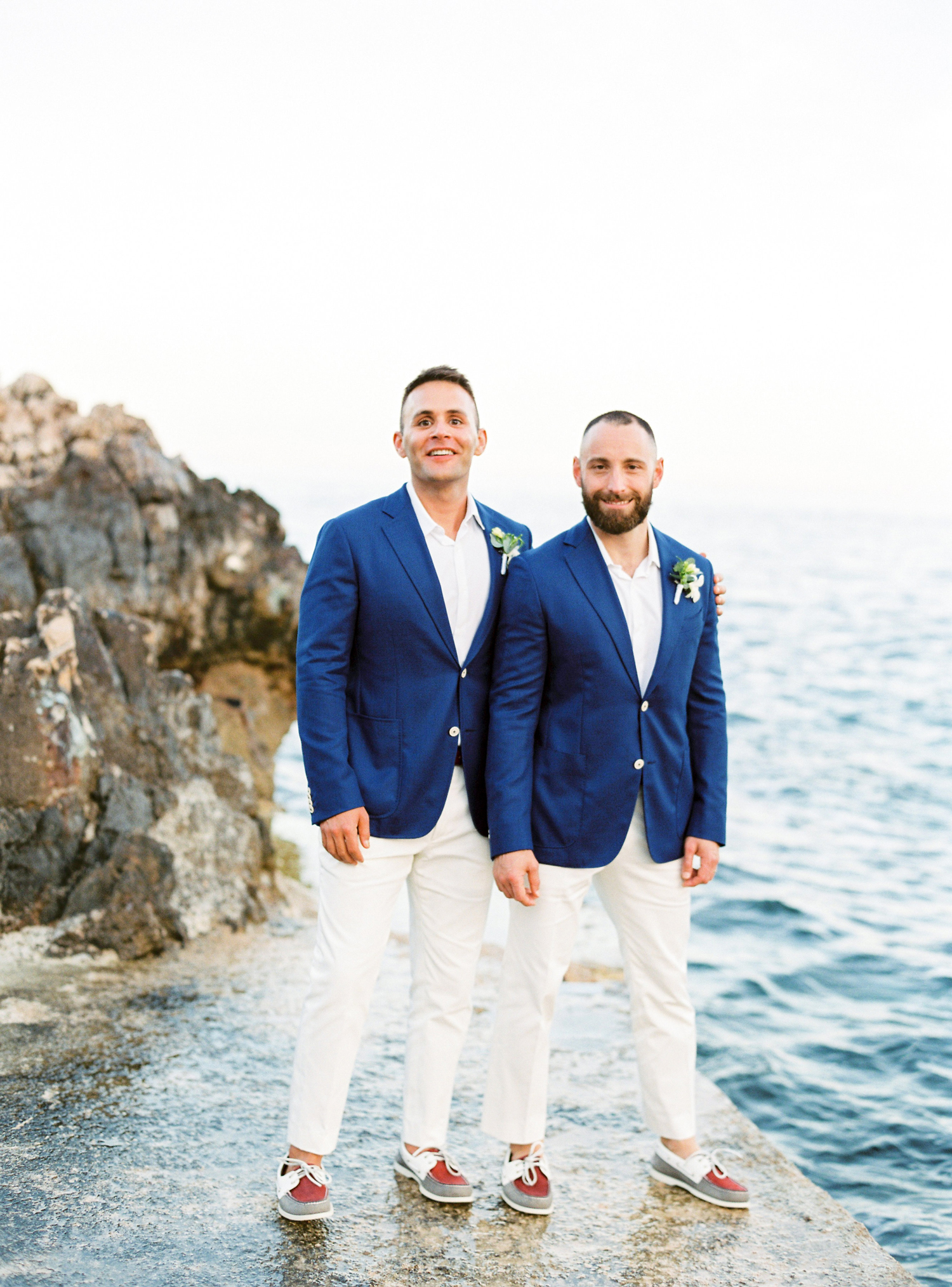 grooms wearing all white suits with royal blue jackets