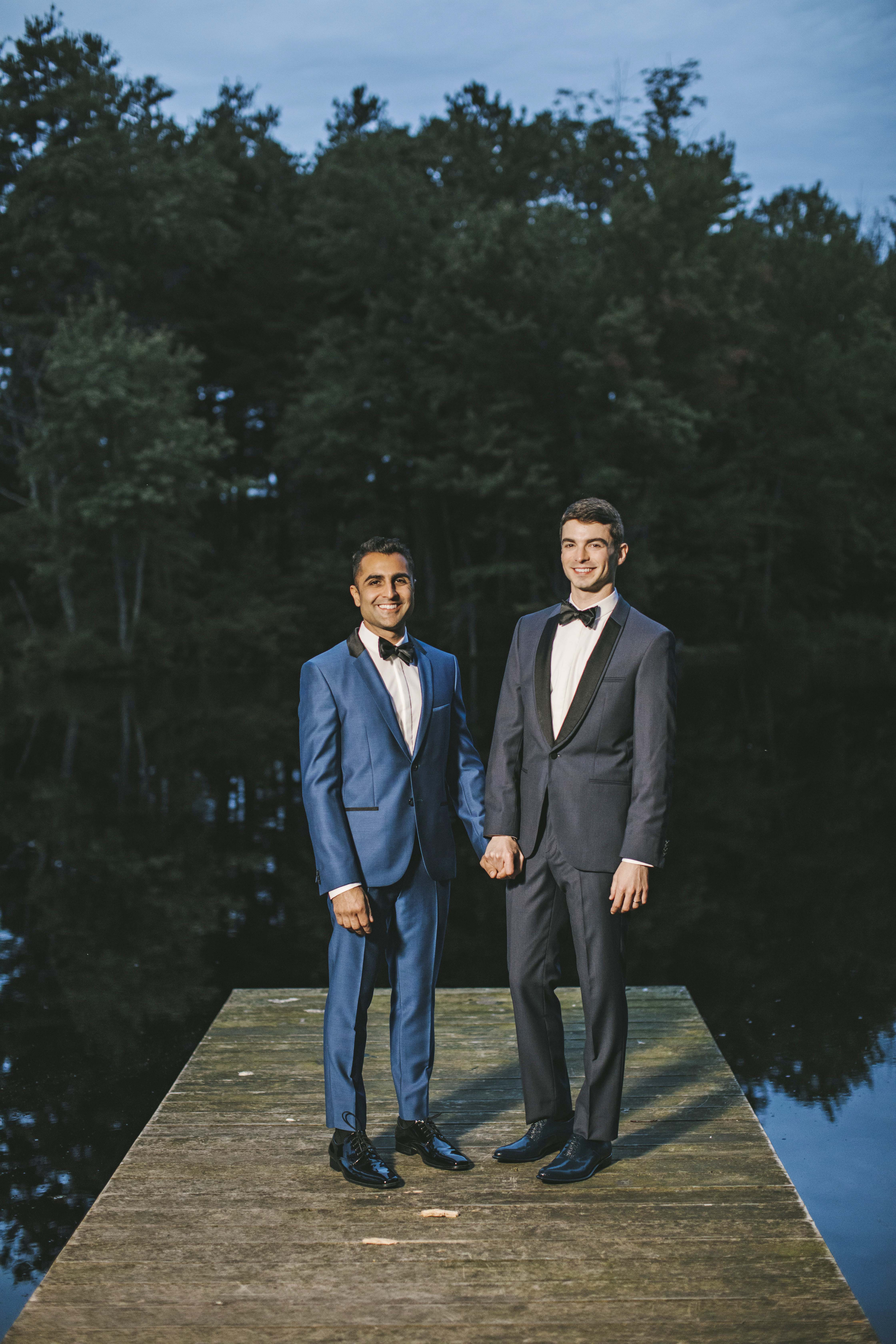 sanjay steven wedding grooms holding hands