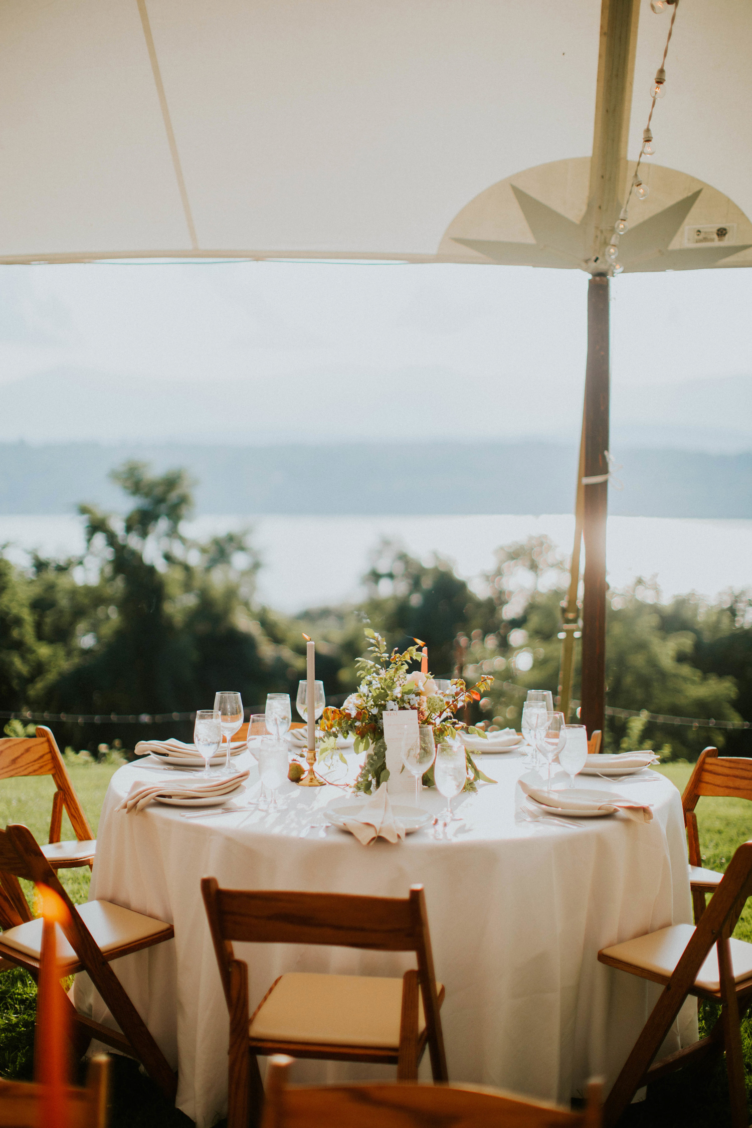 round wedding reception table overlooking the hudson river