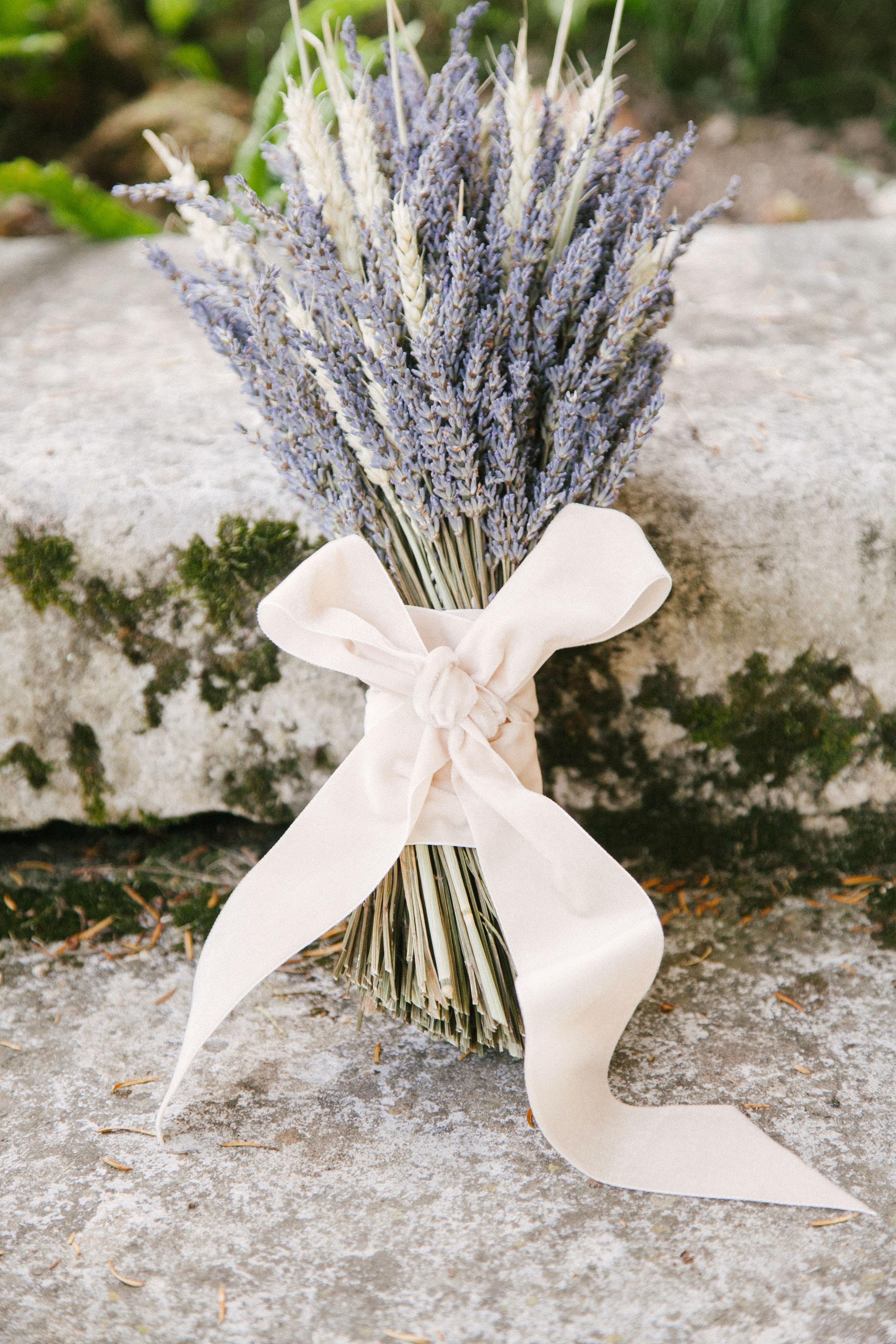 white and purple lavender floral arrangement with velvet bow