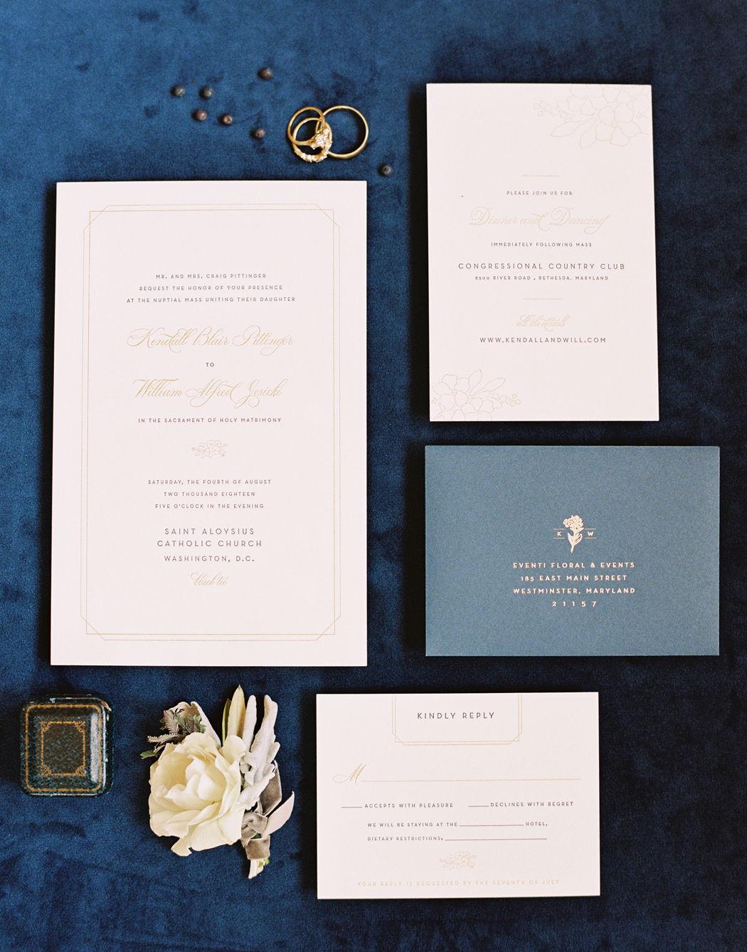 deep blue and white stationary suit with gold calligraphy