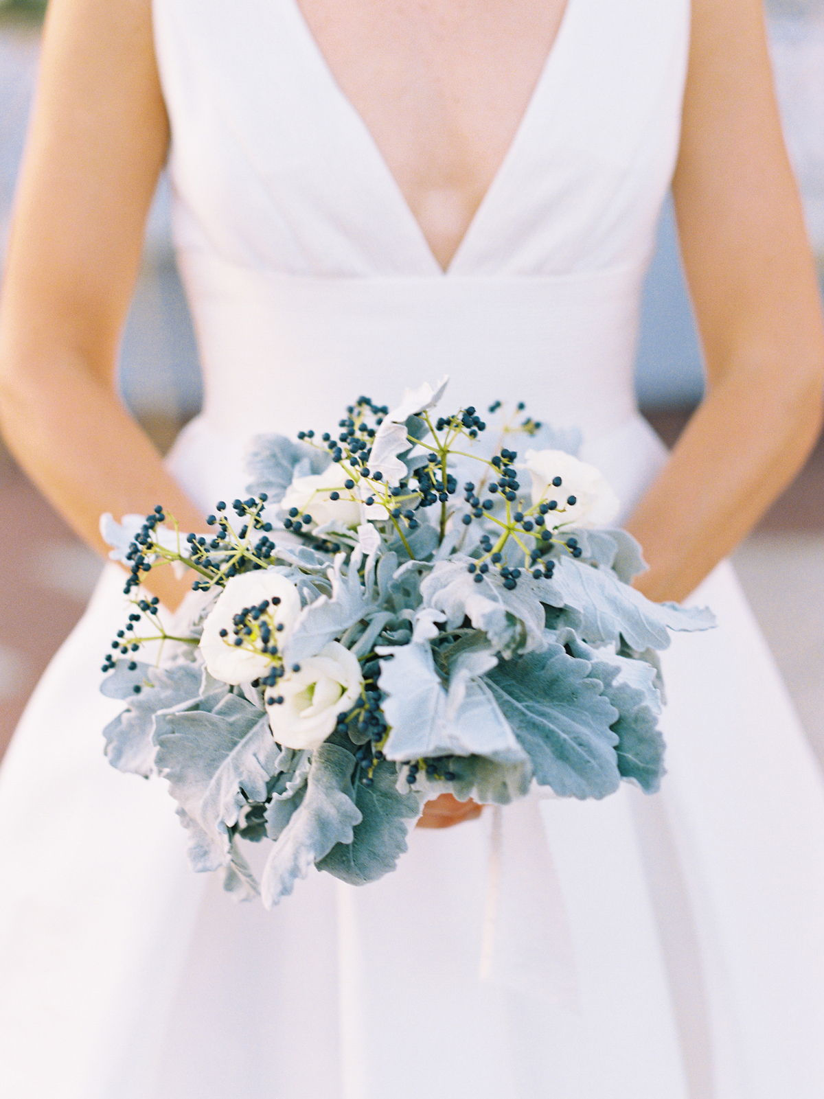 blue and white floral forget-me-not bouquet with privet berries