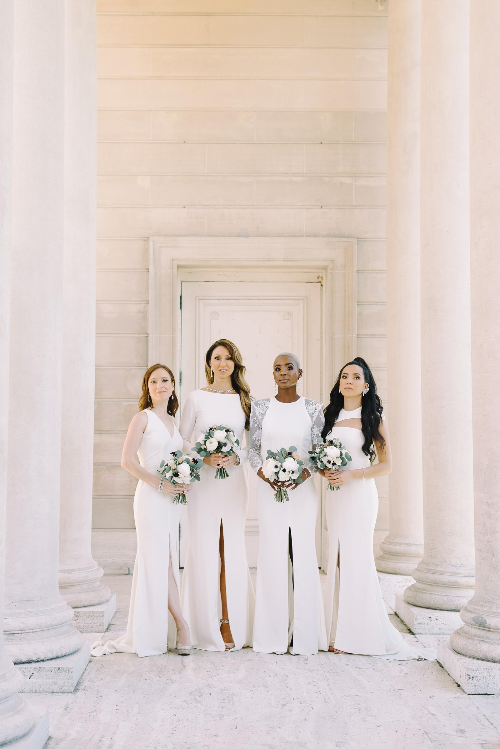 four goomsmaids in custom white dresses