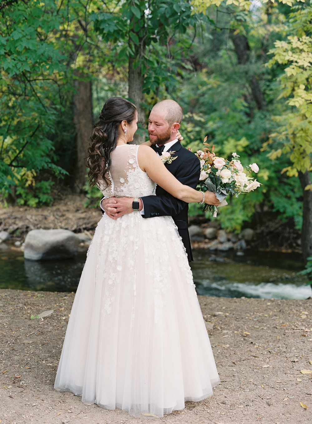 bride and groom first look next to boulder creek