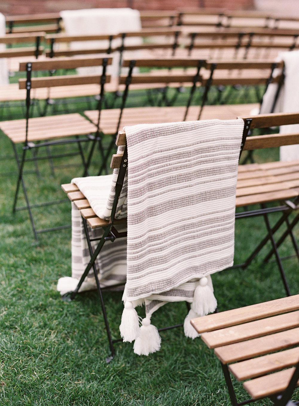 cream colored textured throw blankets over ceremony chairs