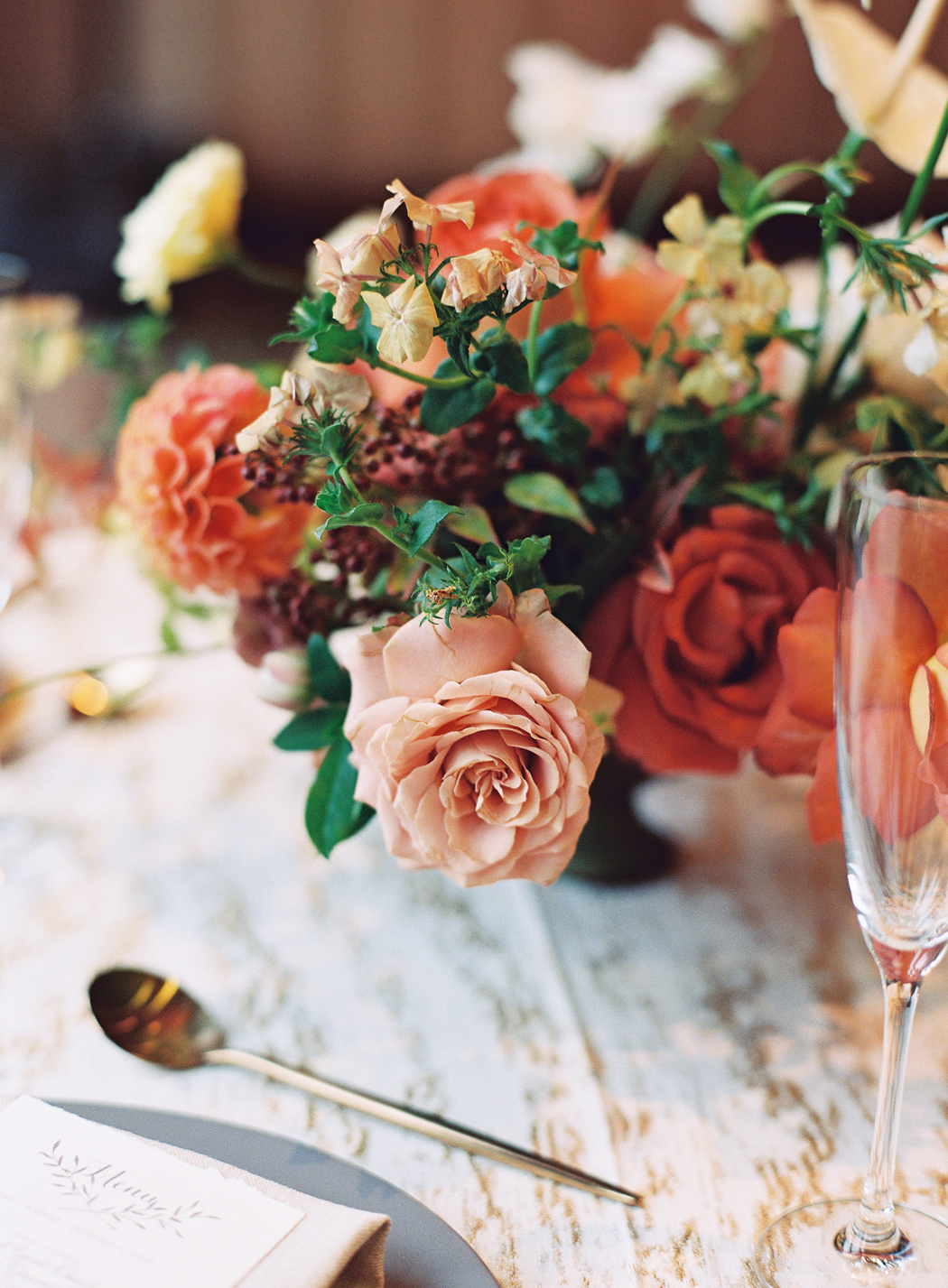 autumn reds and earthly toned floral centerpieces