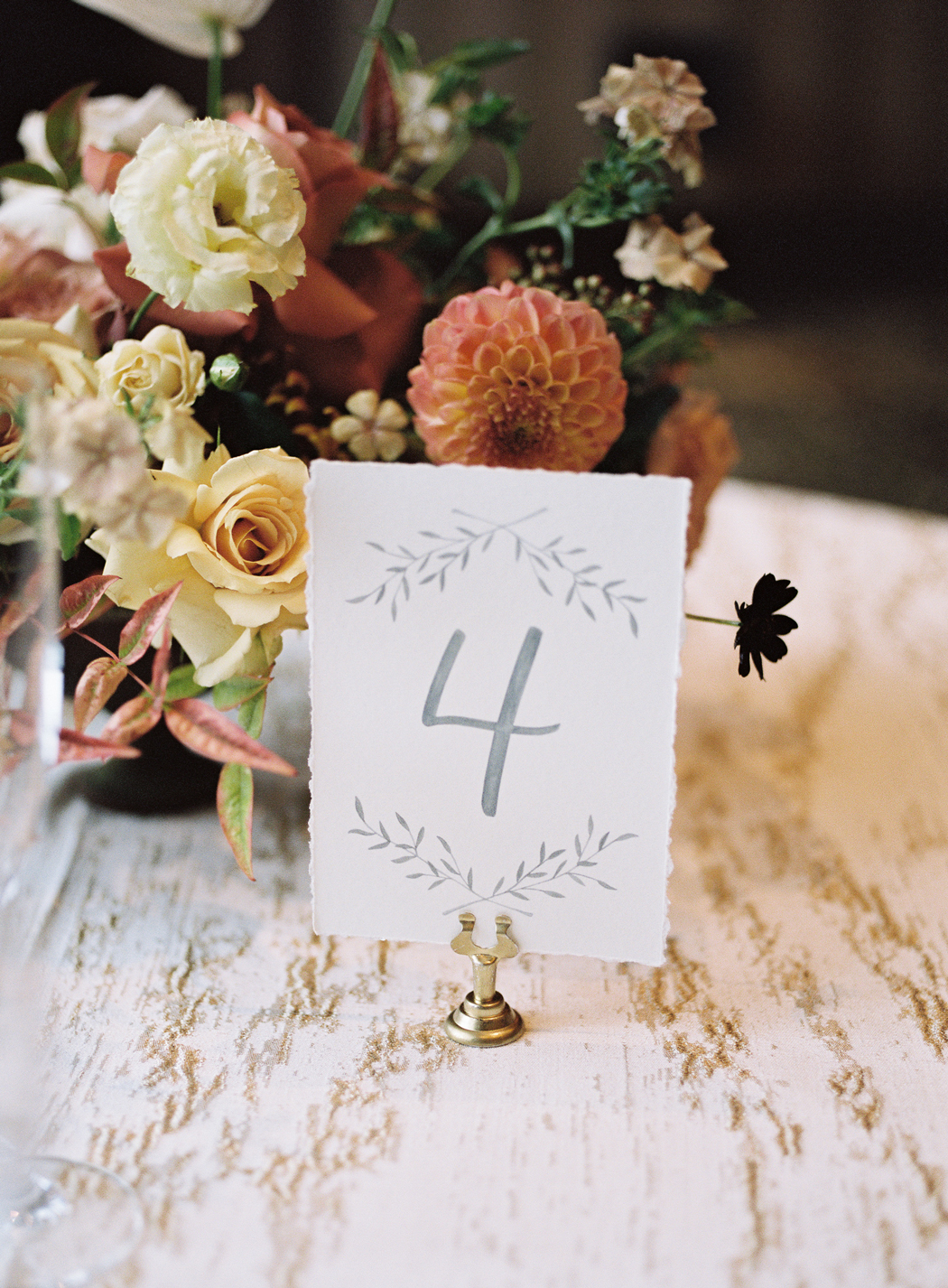 white table number cards with gray writing