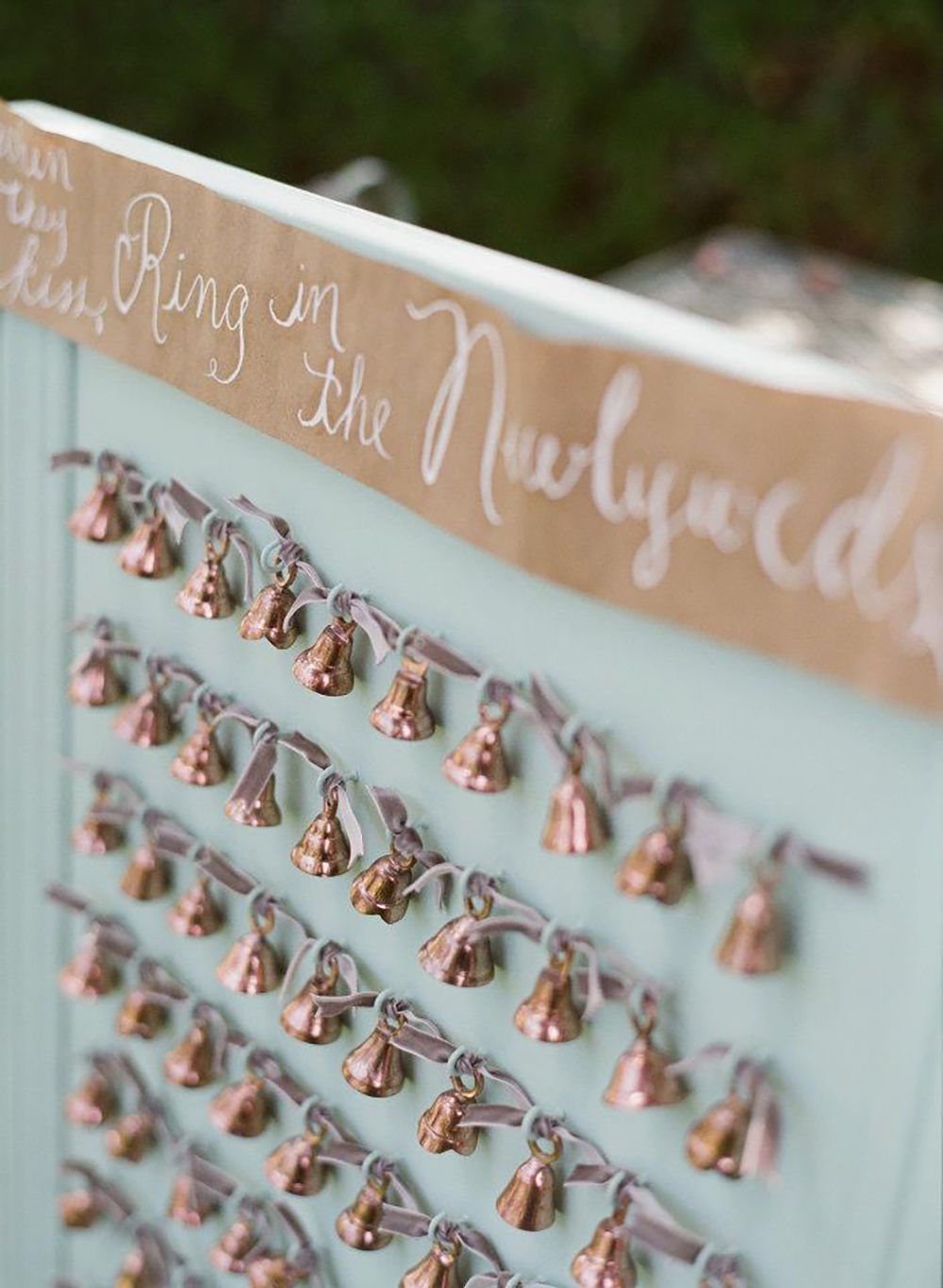Calligraphed wedding bell display for guests