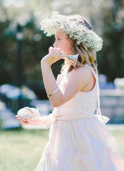 flower girl ringing silver bell