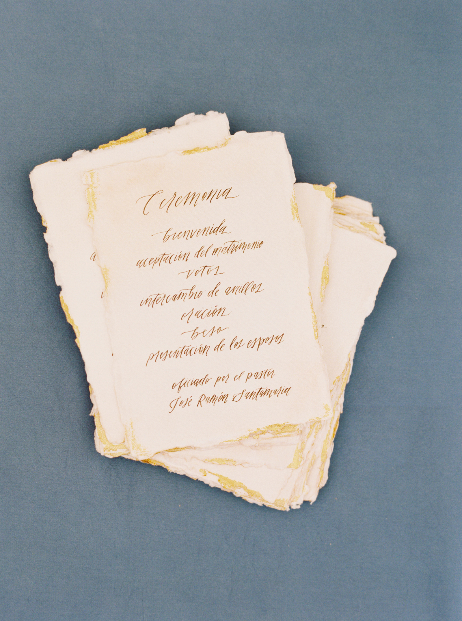 gold calligraphy Spanish written raw edge wedding programs