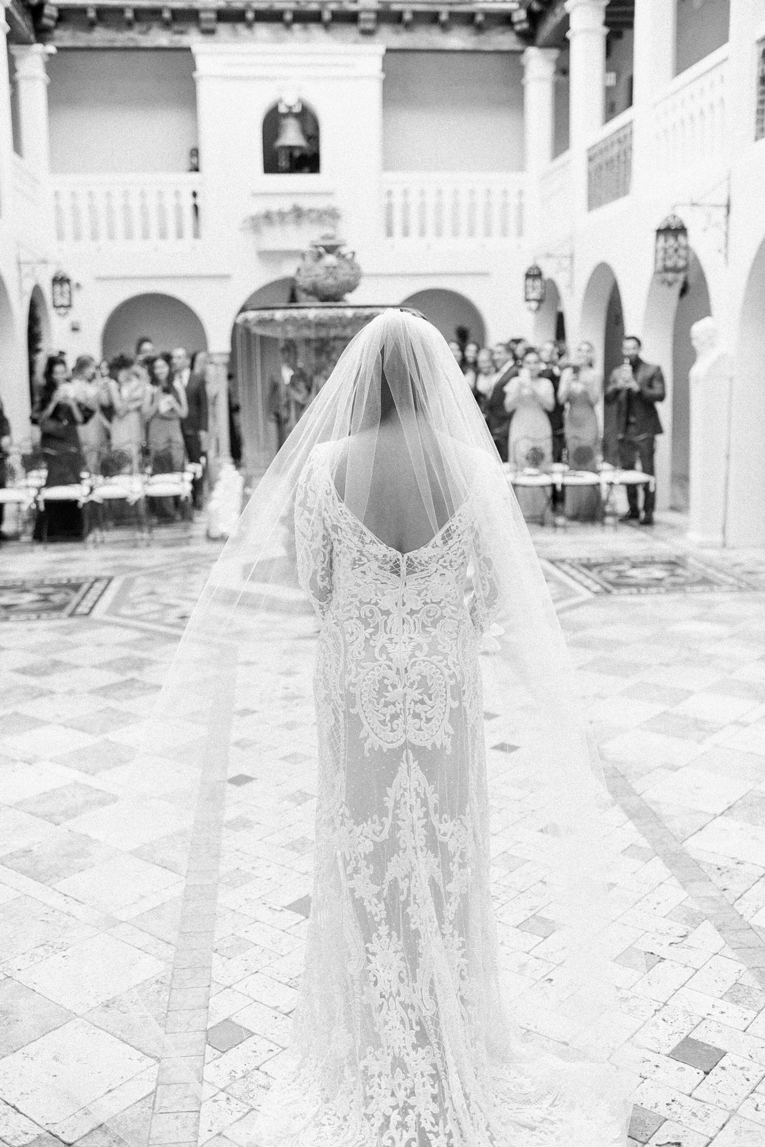 bride walks down wedding aisle unescorted
