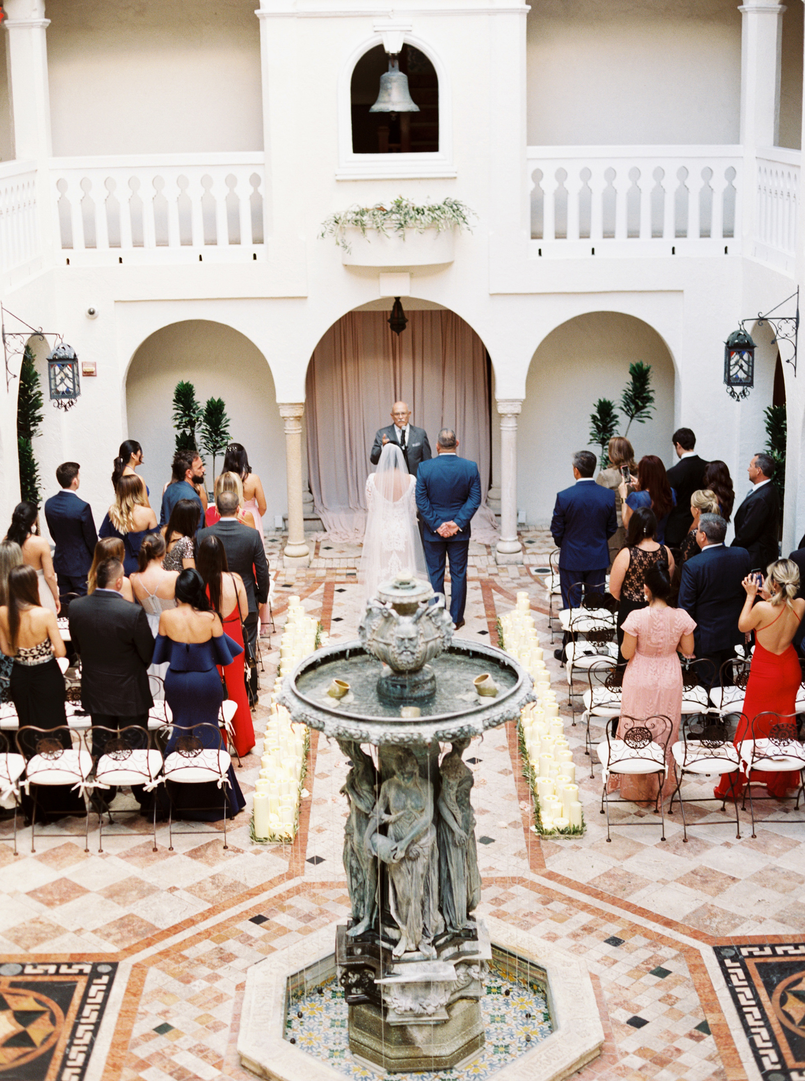bride and groom stand at wedding alter during ceremony