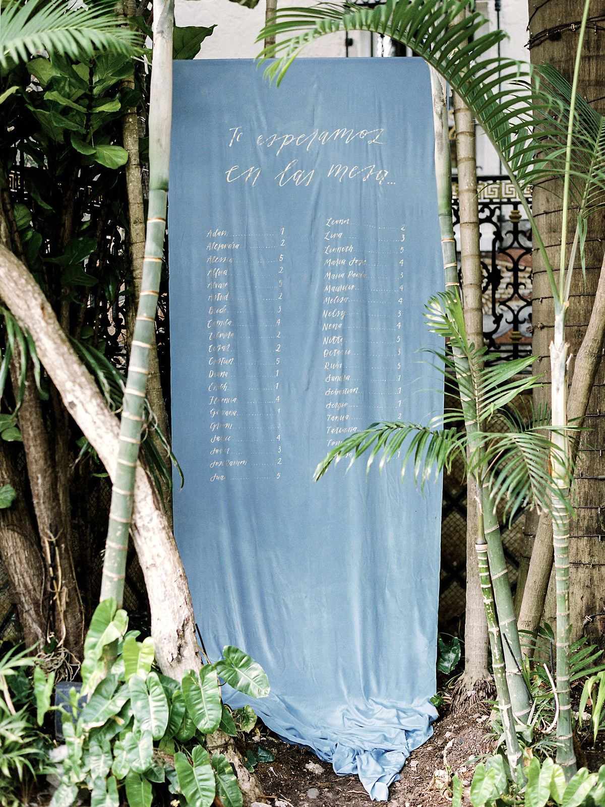 wedding seating chart on blue silk fabric