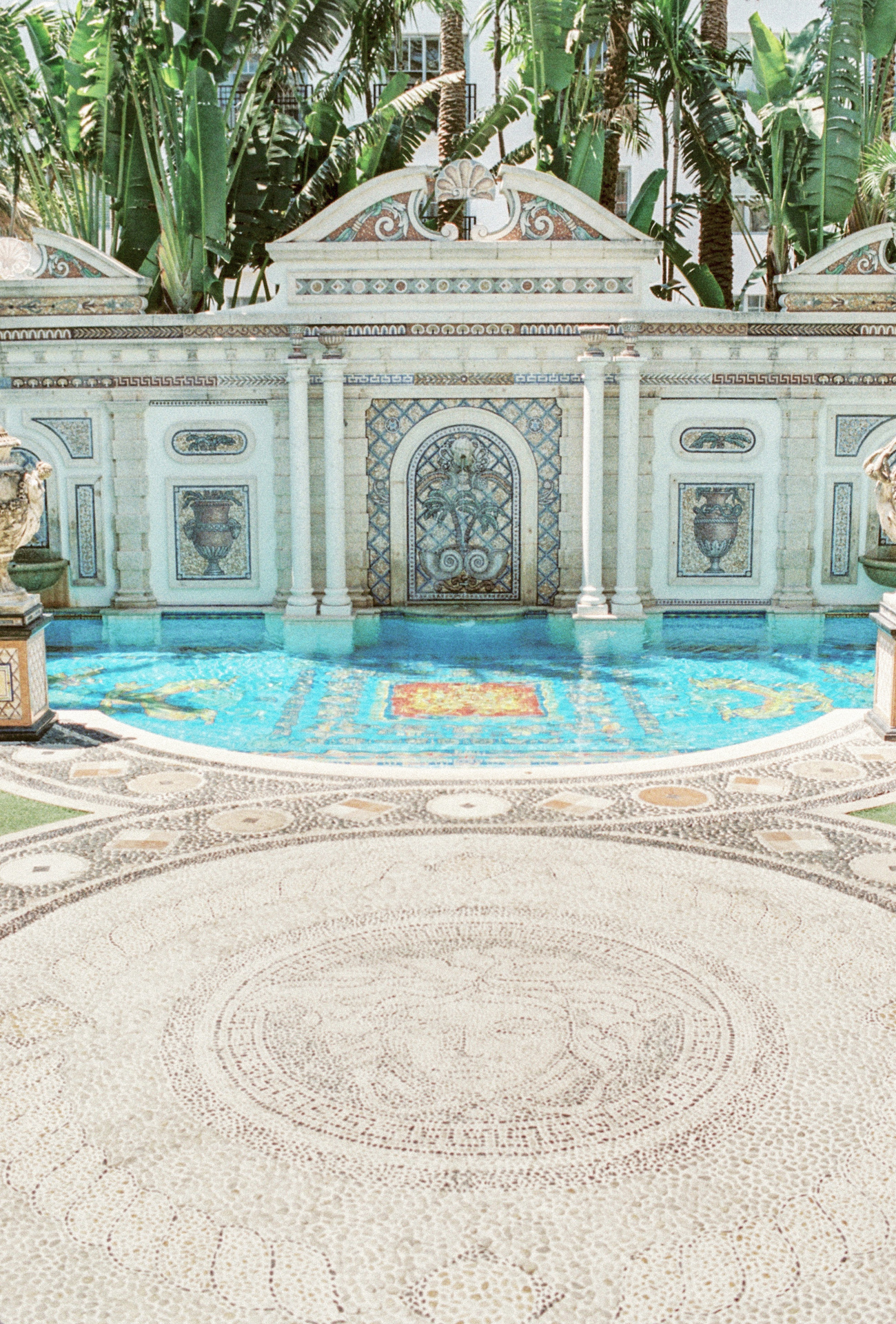 mansion wedding venue outdoor pool with gold tile floor designs