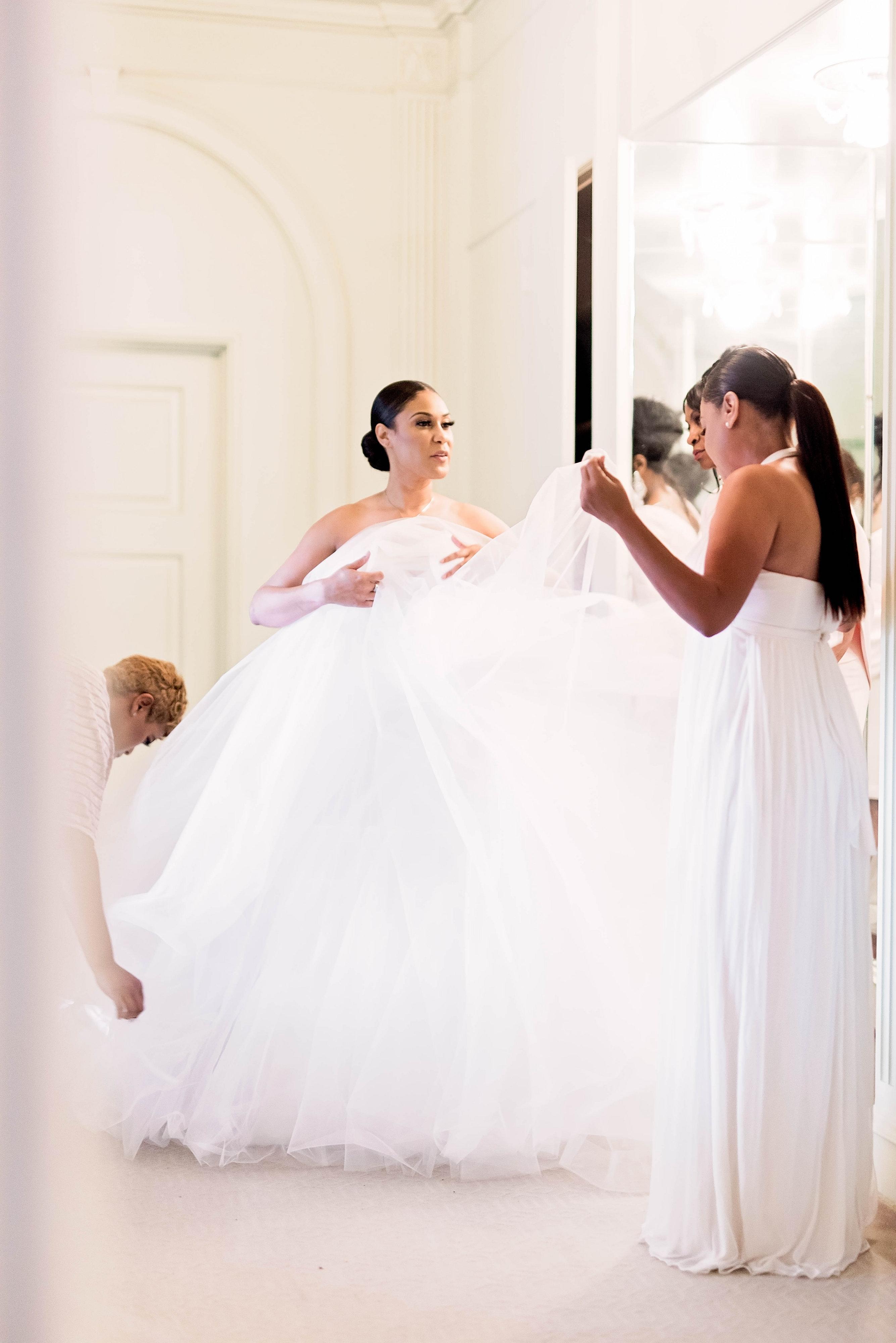 bride getting ready in ballgown dress