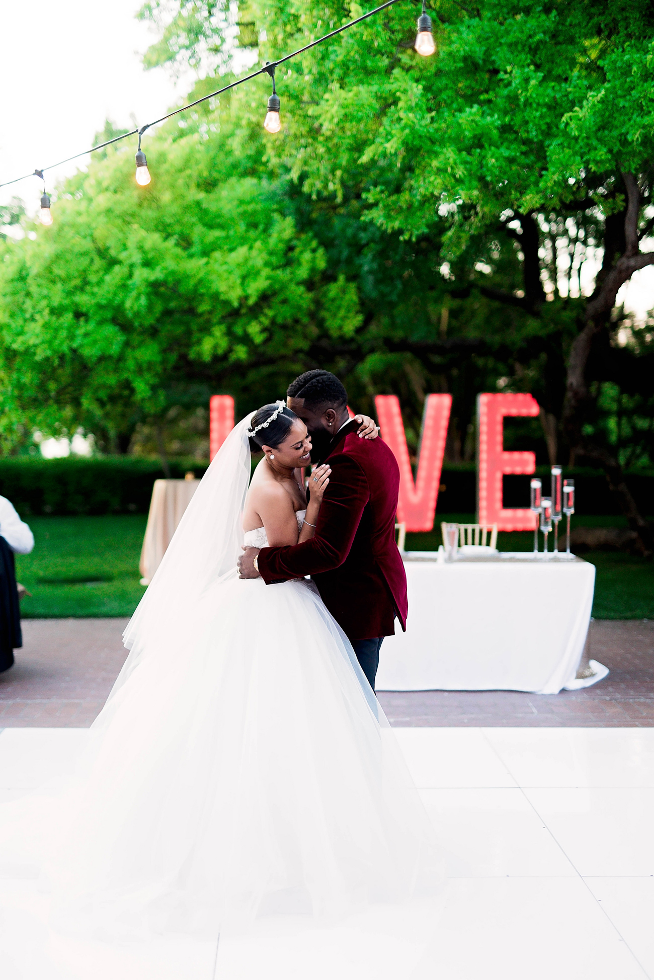 bride and groom hold each other during first dance