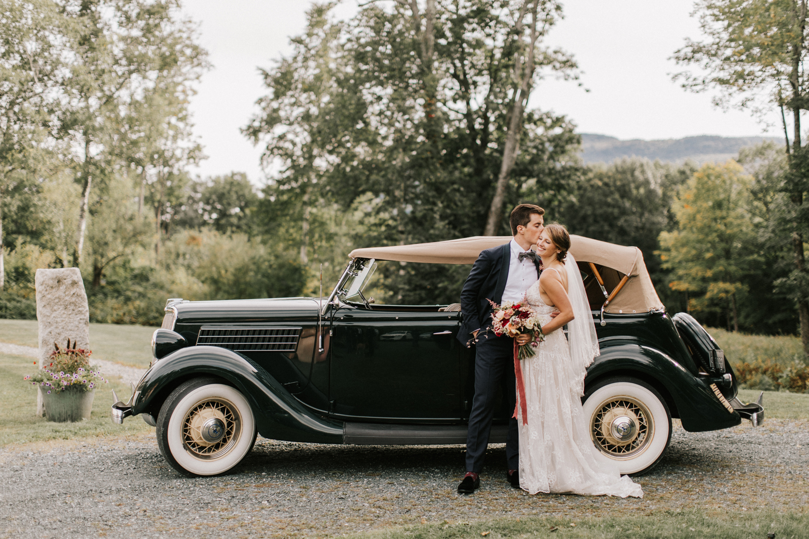 bride and groom standing next to 1936 Model A Ford vintage car