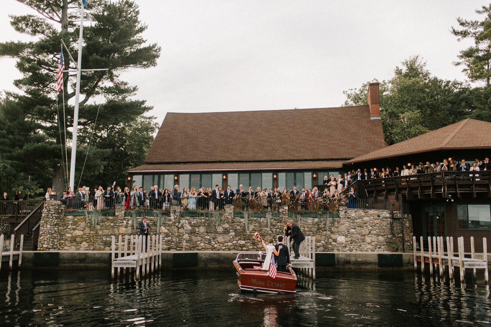 bride and groom arrive in boat for reception