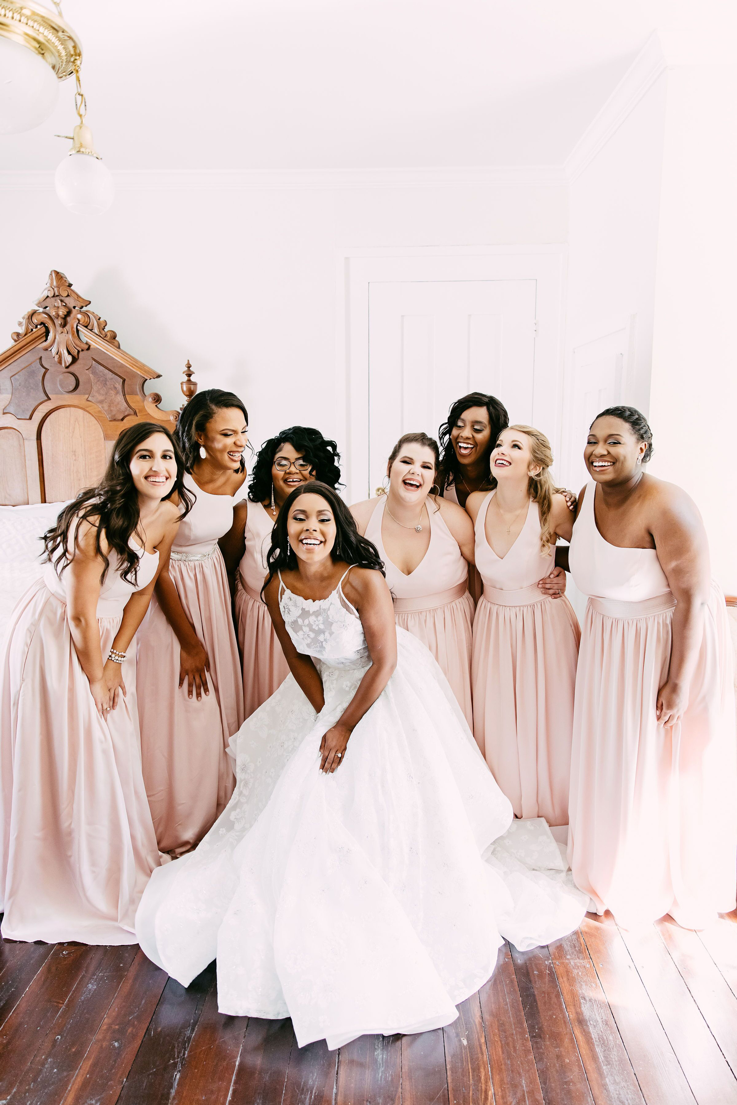 bride with bridesmaids wearing pale pink dresses