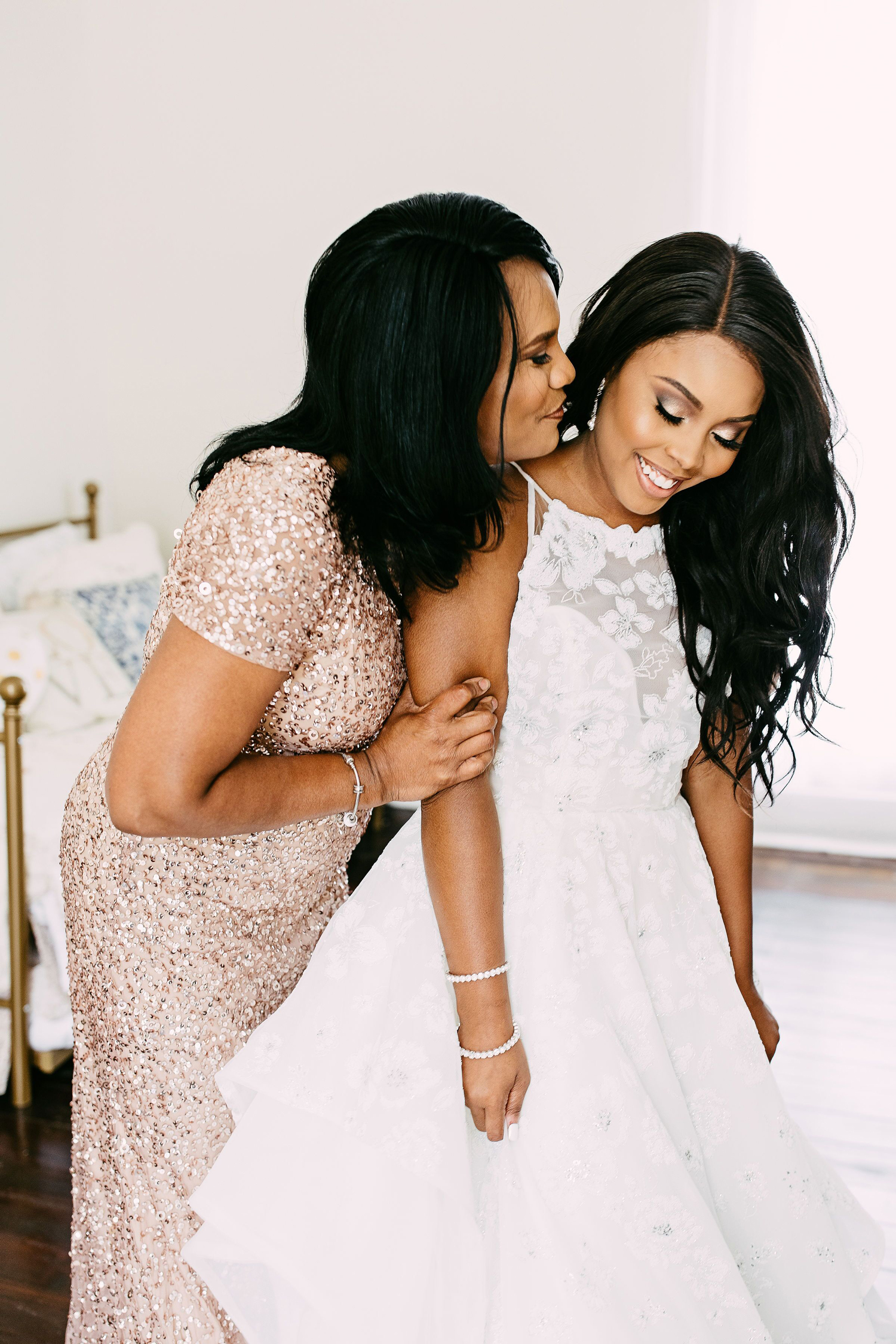mother of the bride and bride embracing