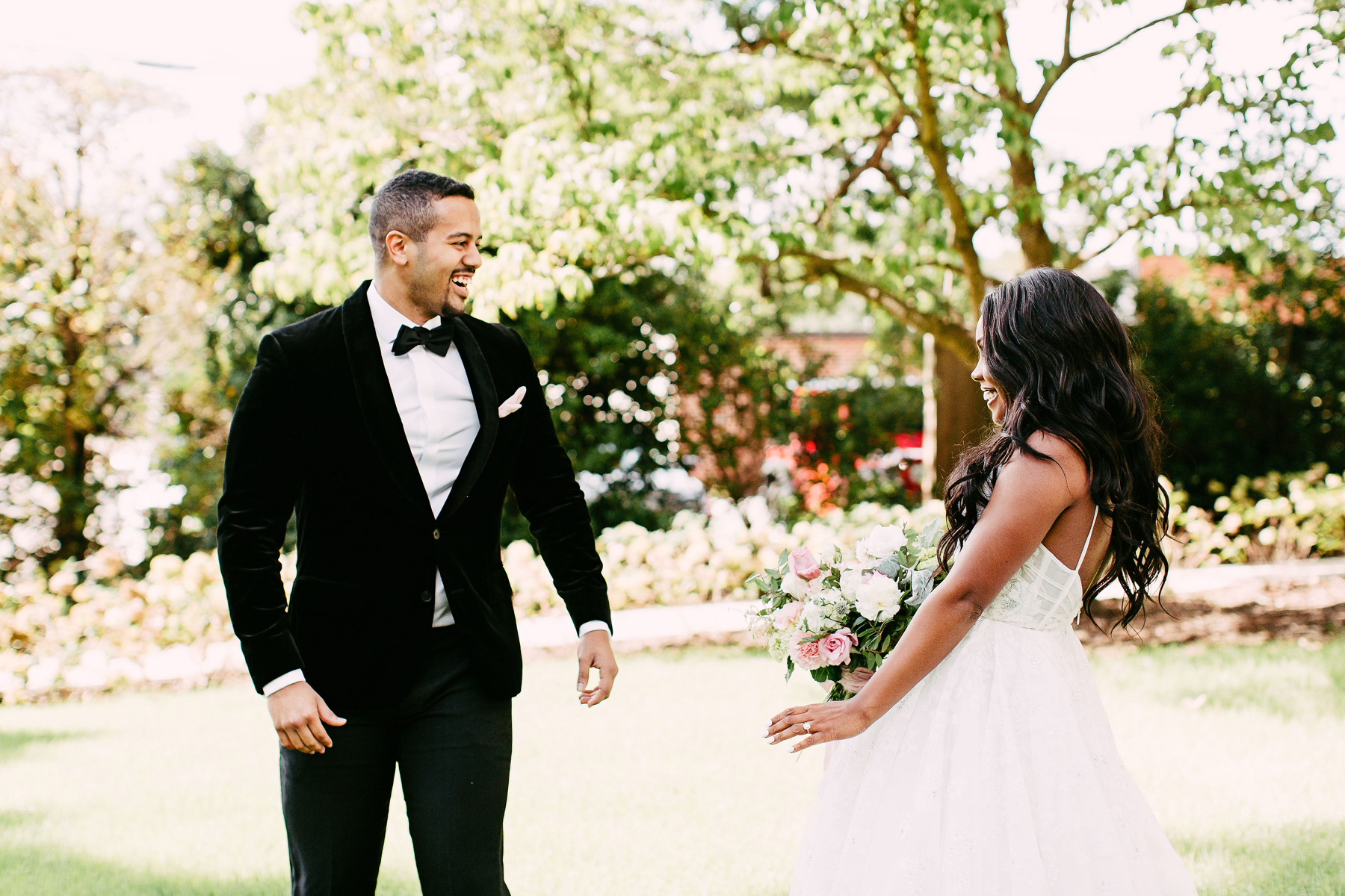 bride and groom sharing first look