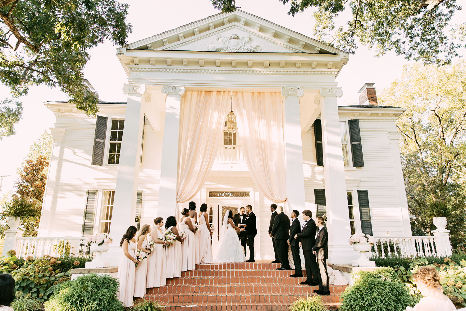 wedding ceremony on porch of mansion