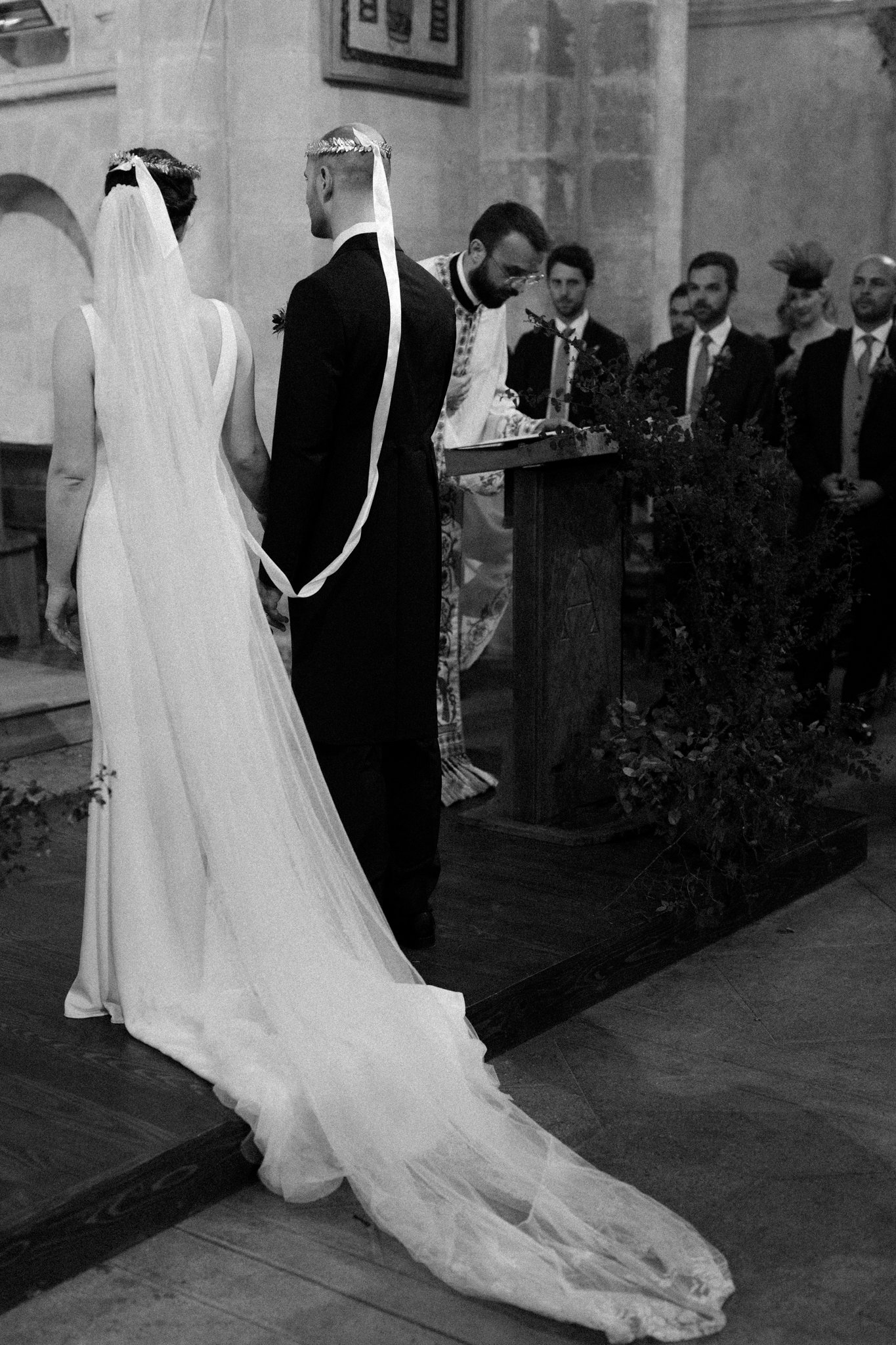 bride and groom wearing wedding ceremony crowns