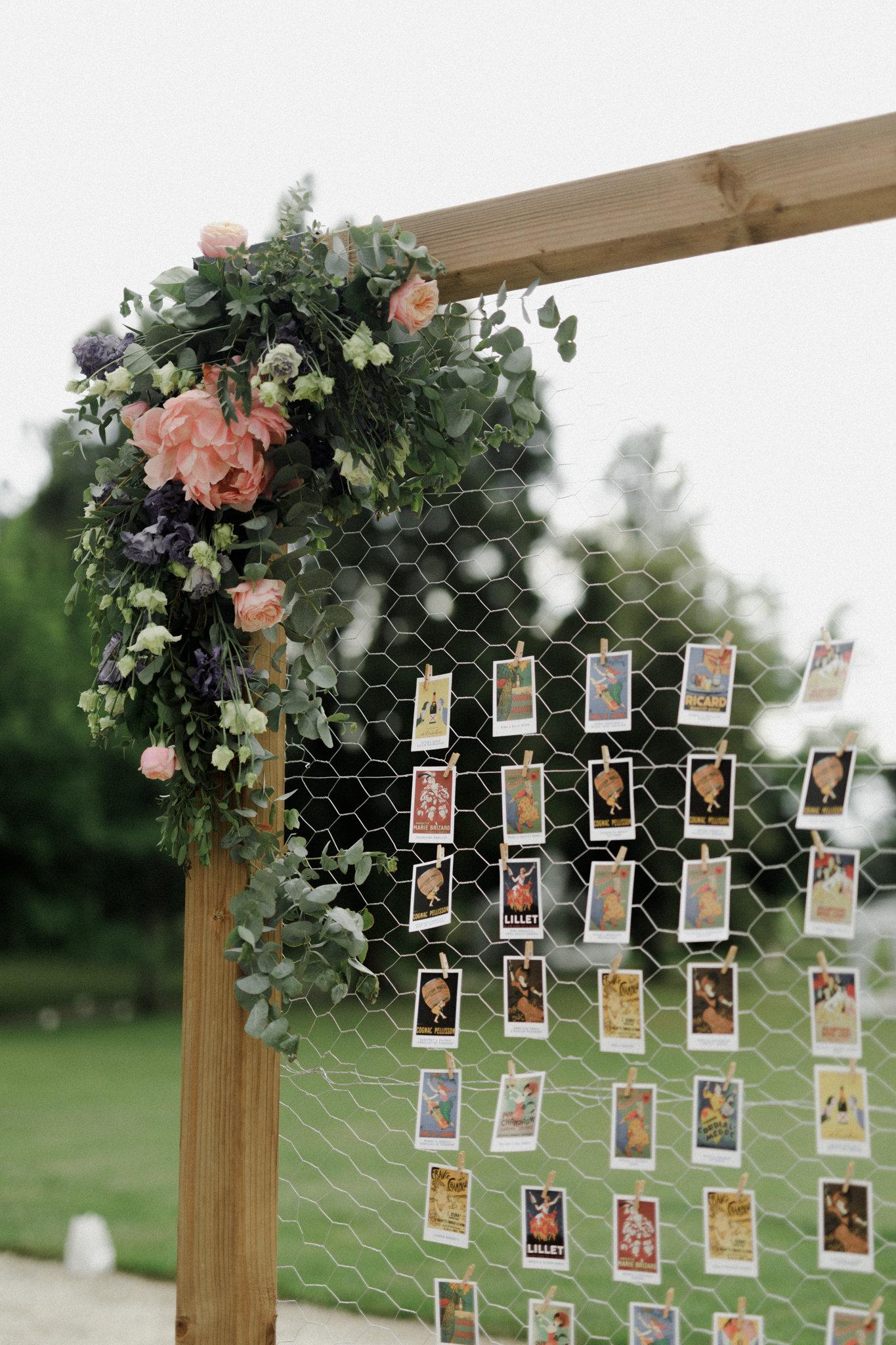 table cards on wooden framed metallic net