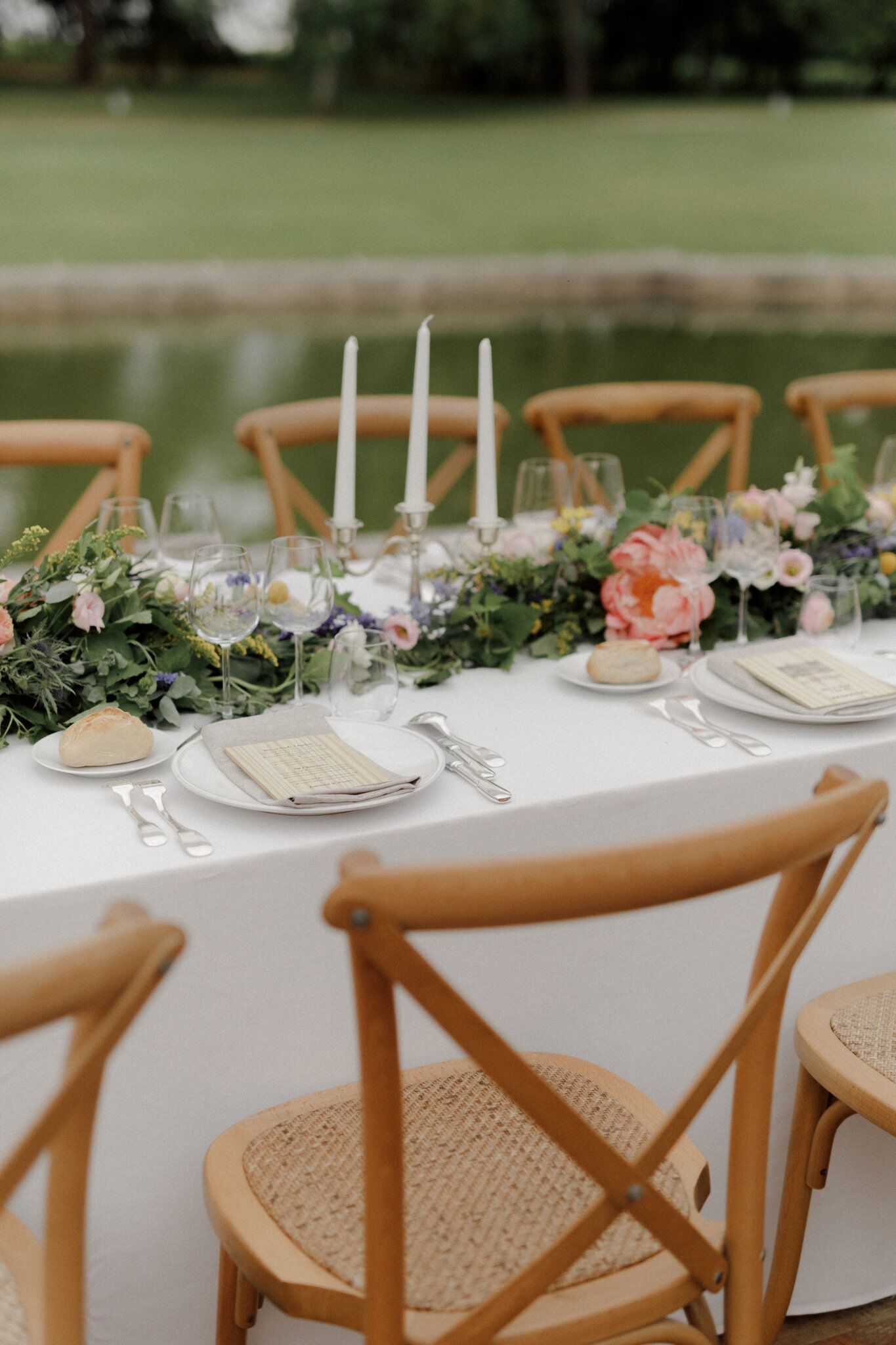 off-white linen with floral centerpieces and tall candlesticks