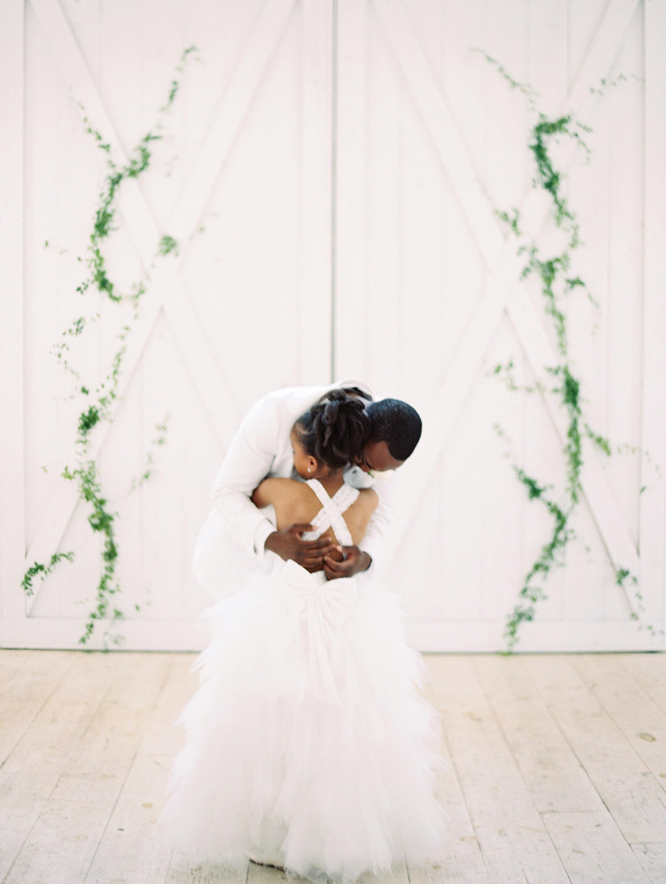 shakira travis wedding junior bridesmaid hugging groom