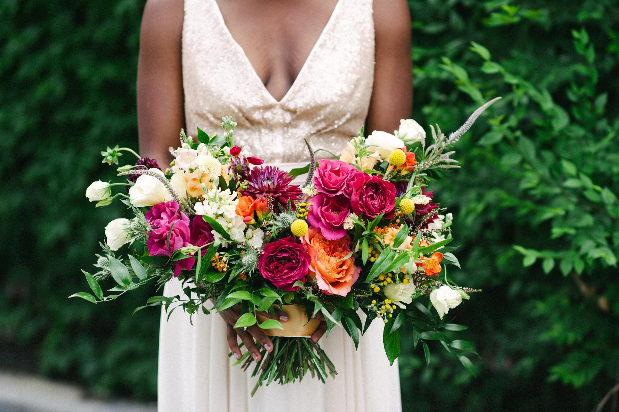 steph tim wedding bride bouquet of pink white orange flowers