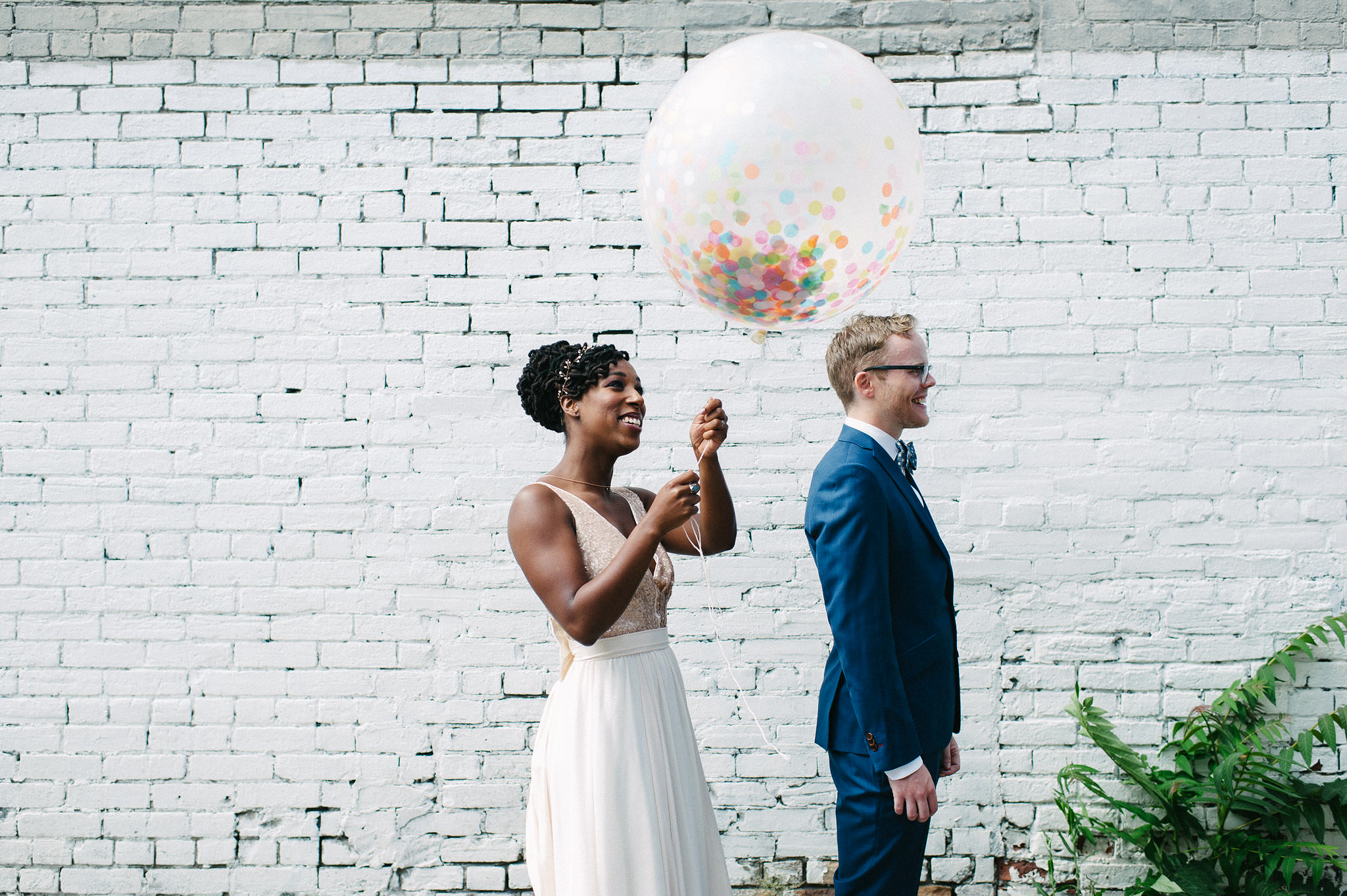 steph tim wedding couple first look confetti balloon