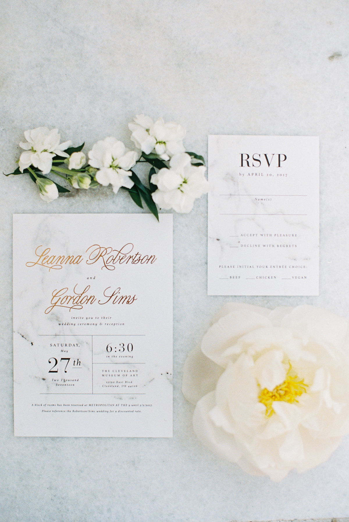 rose gold and black writing on white marble print stationary