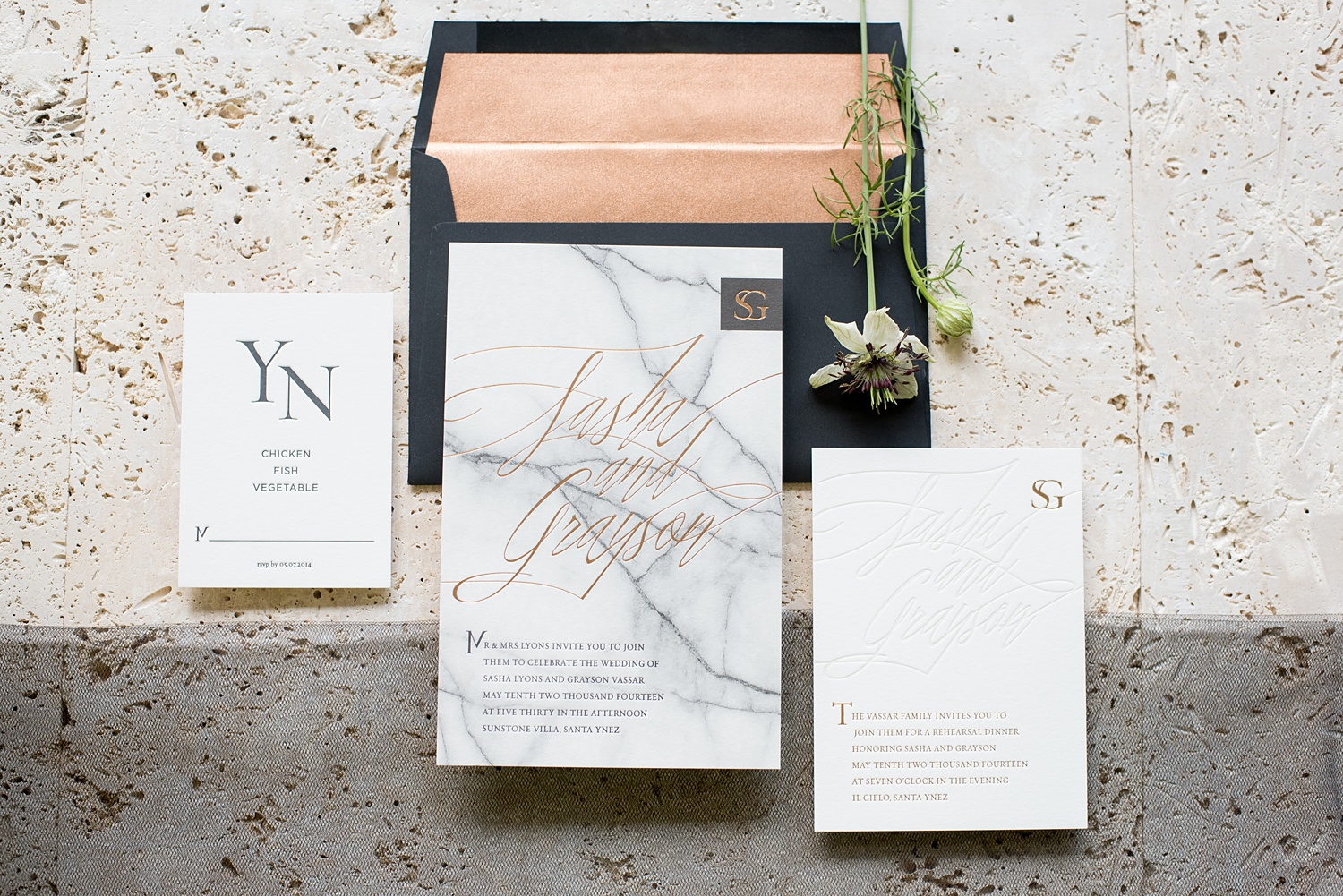 white and gray marble print stationary suit with copper calligraphy and black writing