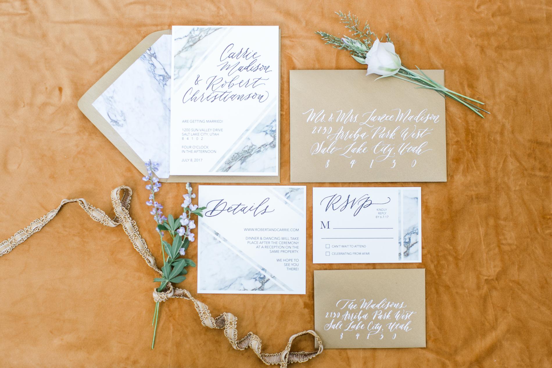 white marble printed stationary wedding invites