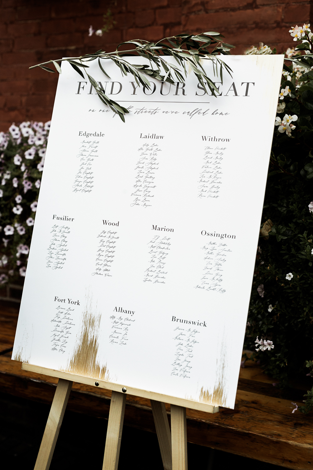 white seating chart with gold foil and olive branch accents
