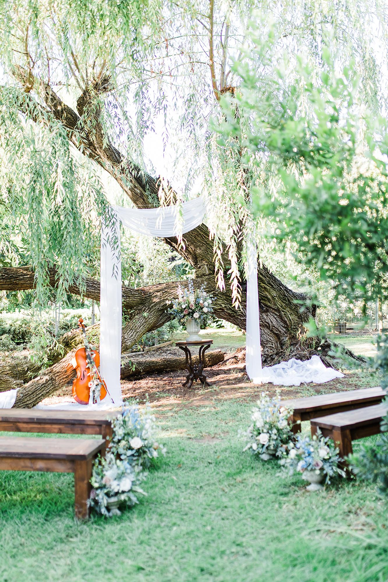 outdoor wedding altar with cello
