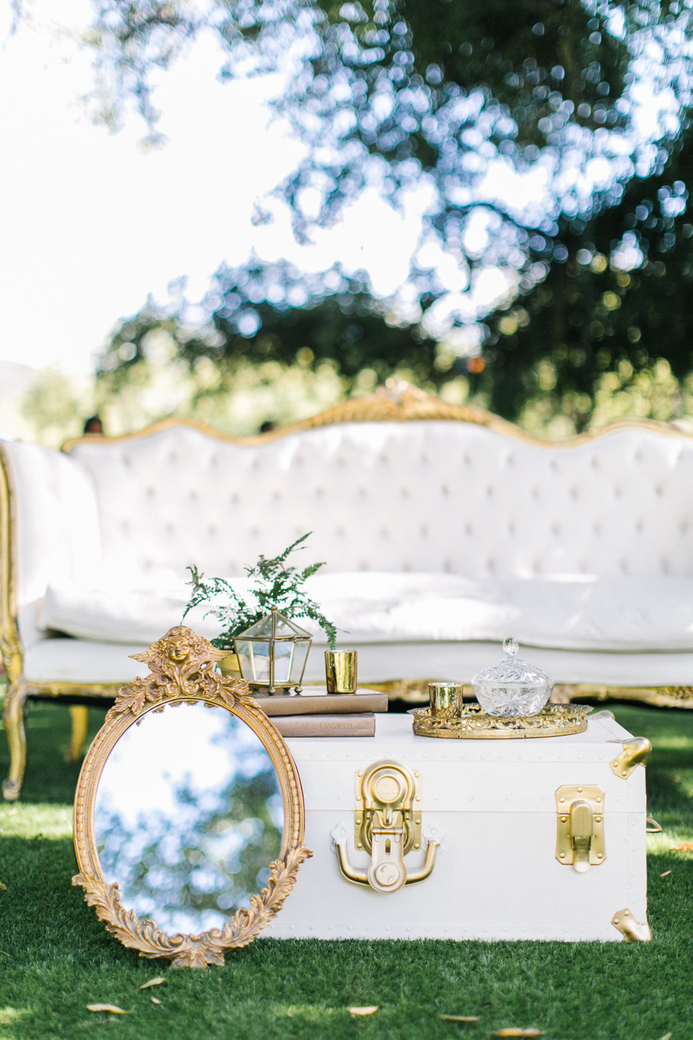 outdoor reception seating area with mirror