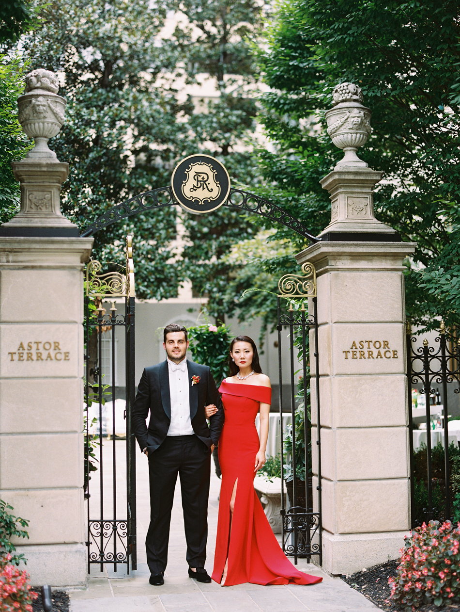 groom with bride wearing red reception dress