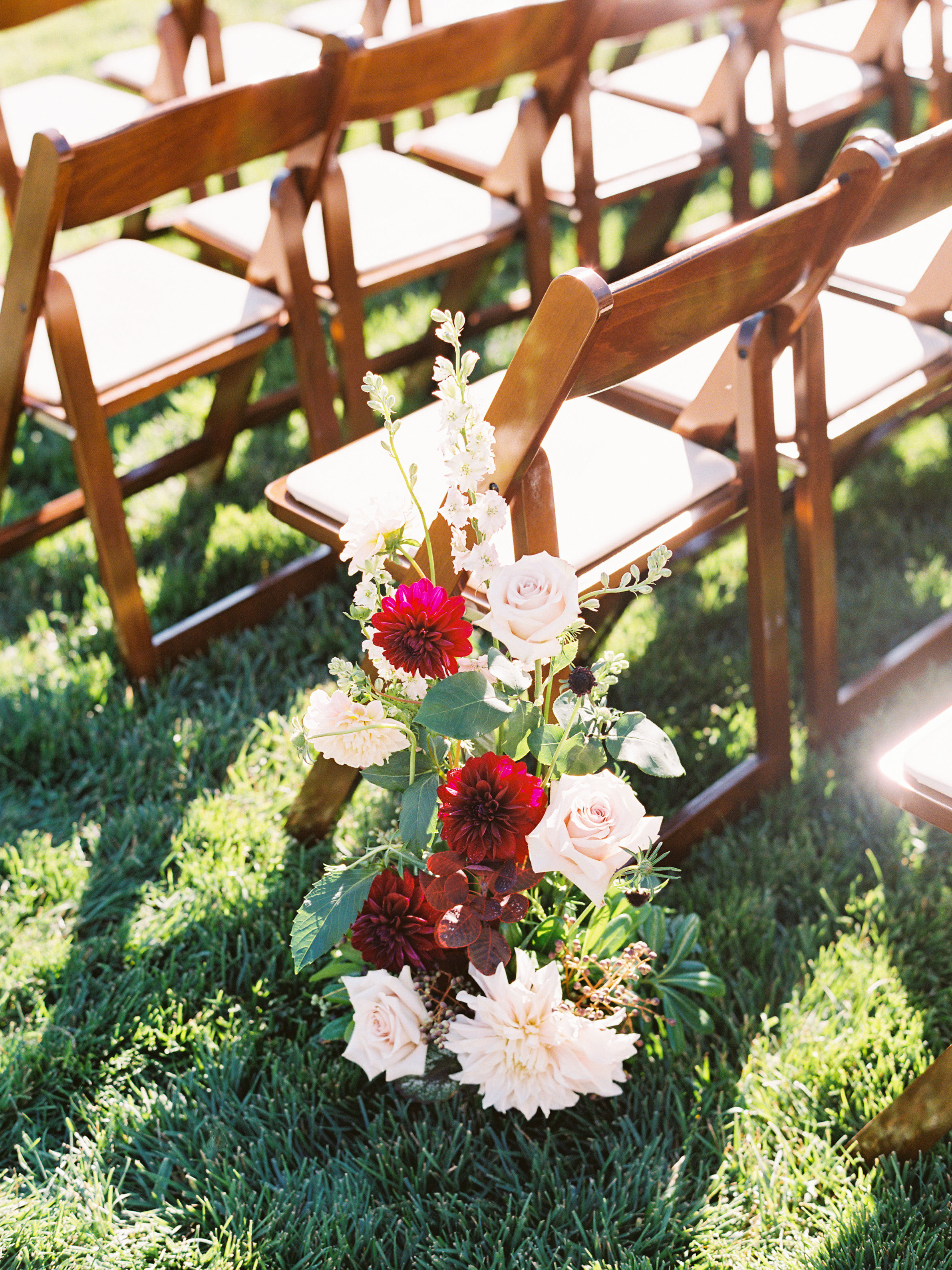 dianna amar wedding ceremony flowers on chair