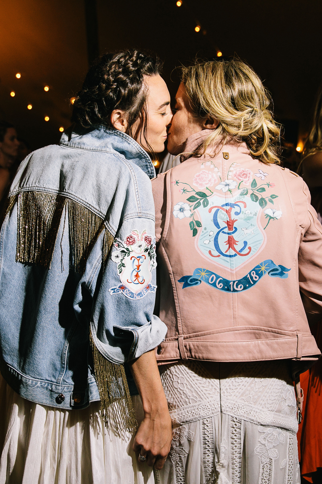 brides wearing custom designed leather and jean jackets