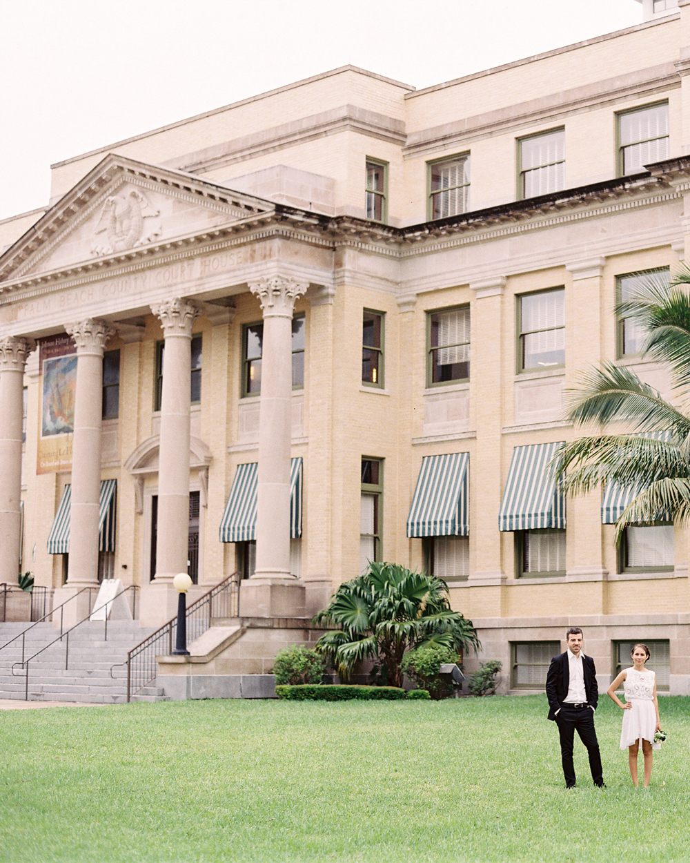 city hall wedding bride and groom standing outside of palm beach county courthouse