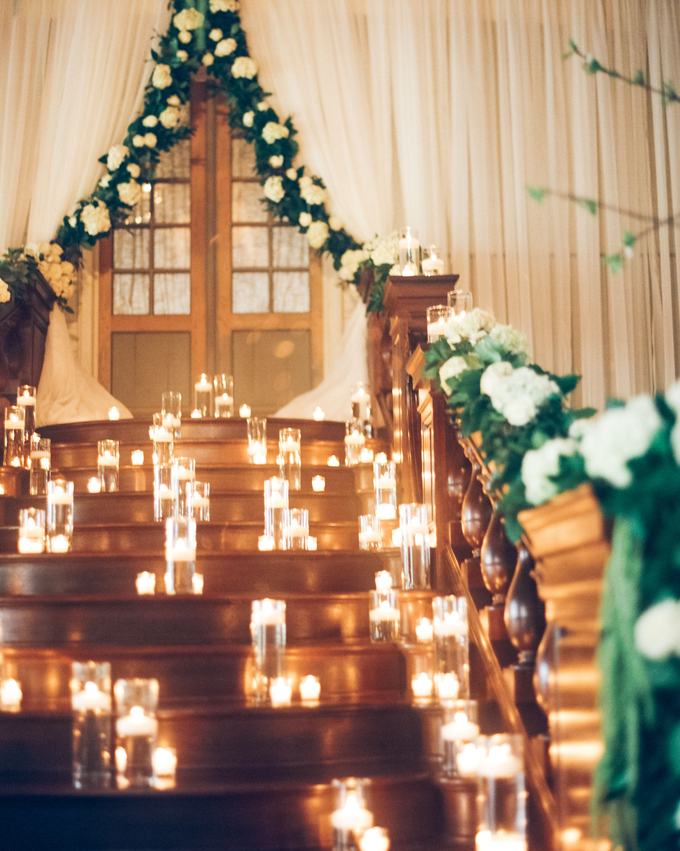 stair banister decor candle lighting greenery backdrop