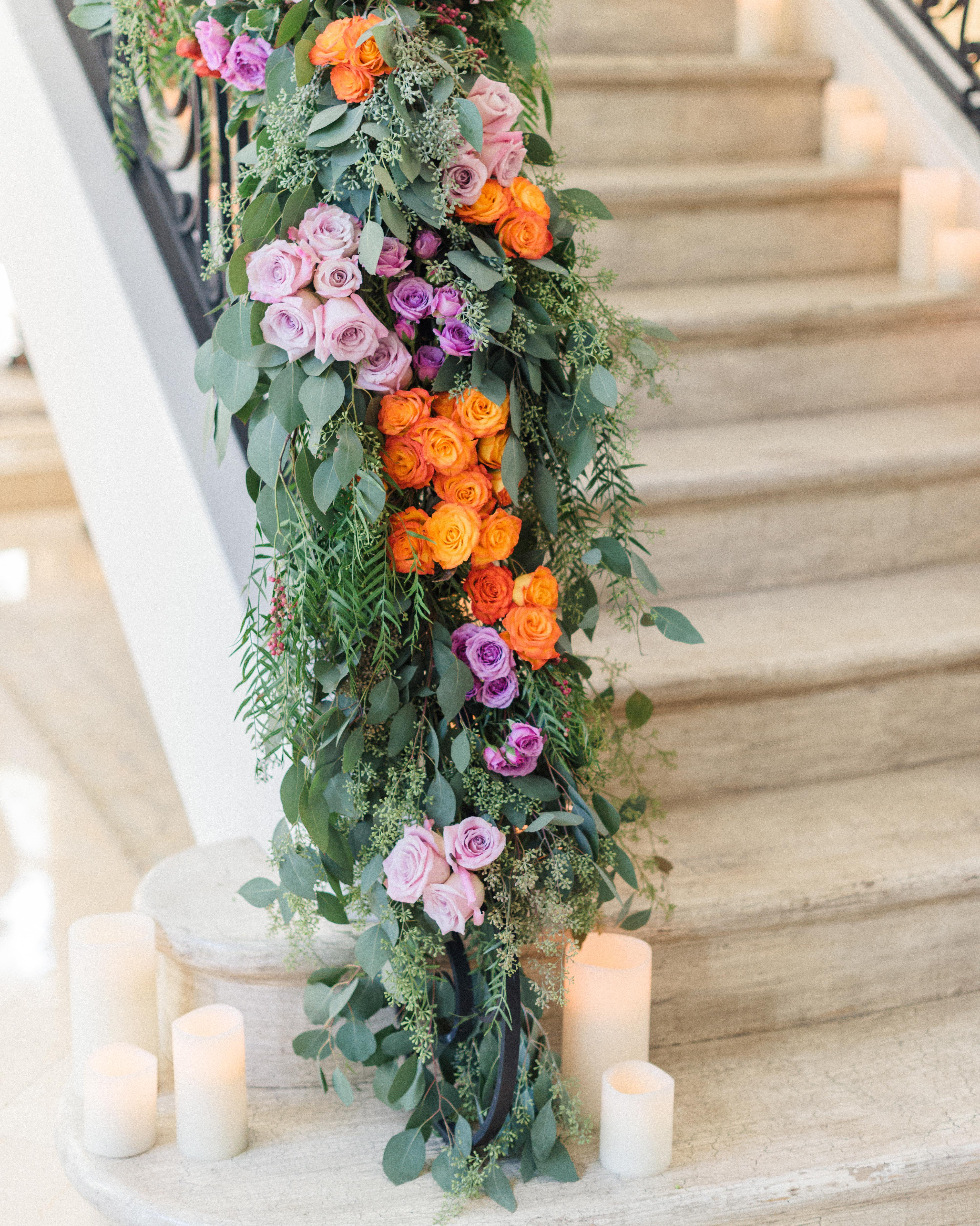 stair banister decor bright flowers with pillar candles