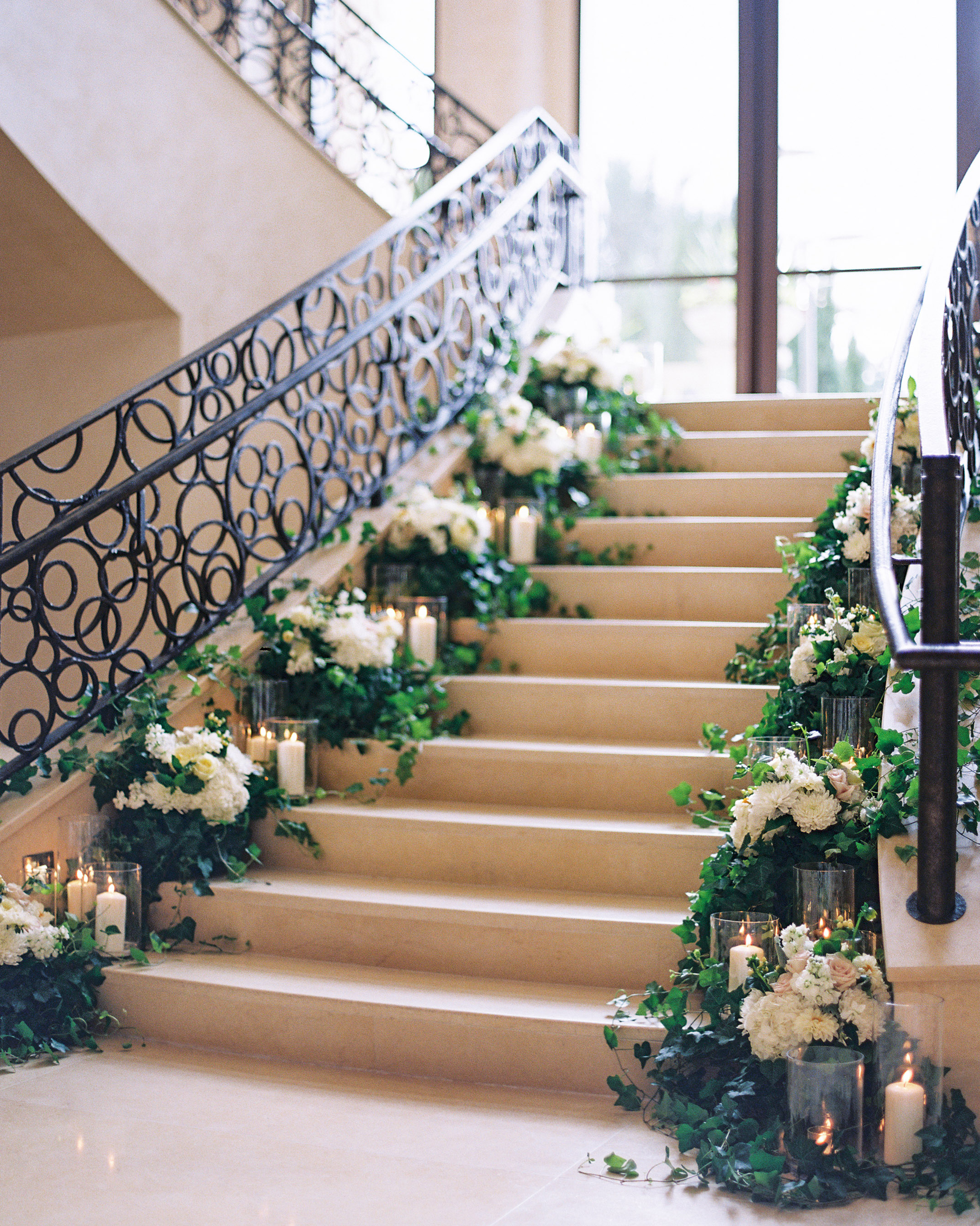 stair banister decor floral candle ceremony backdrop