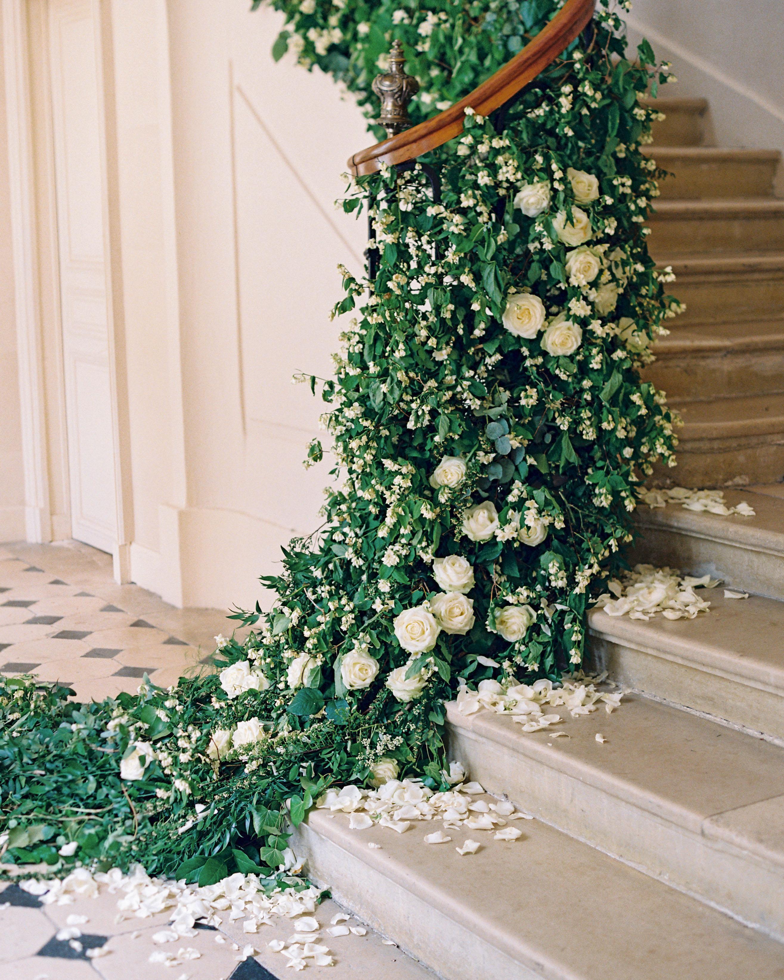 stair banister decor dense greenery white flowers