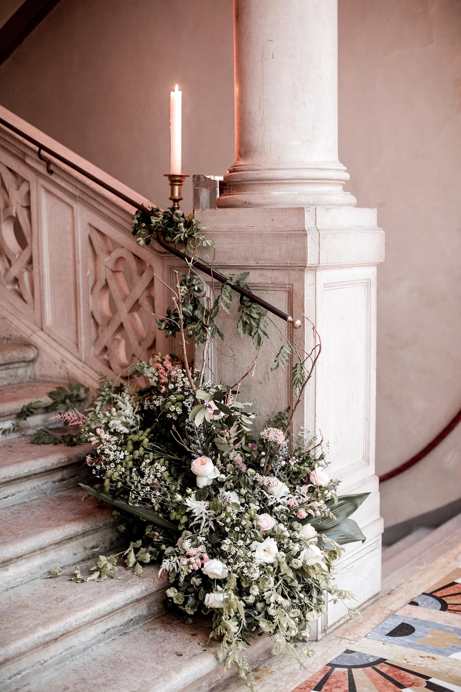 elle raymond venice wedding stairway floral decor