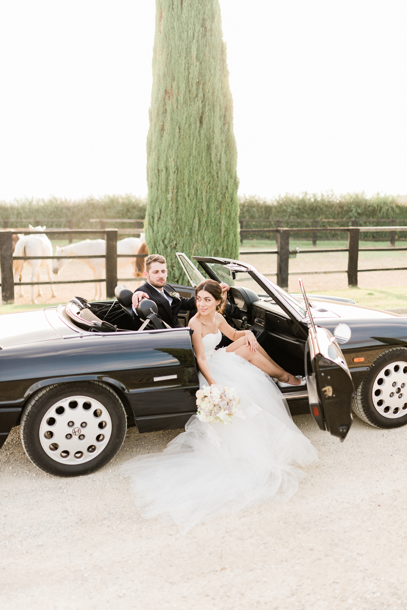 bride and groom sitting in black vintage car